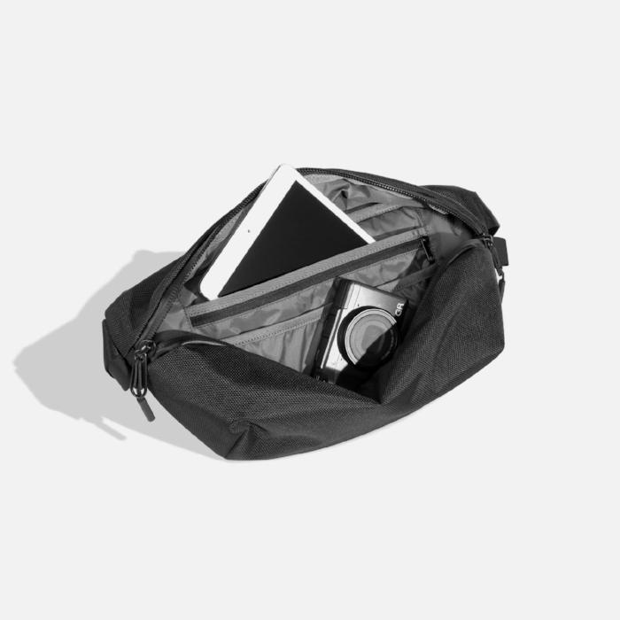 Nice travel slang bag. Very clean. Very Minimal. $60 at   Aer   .
