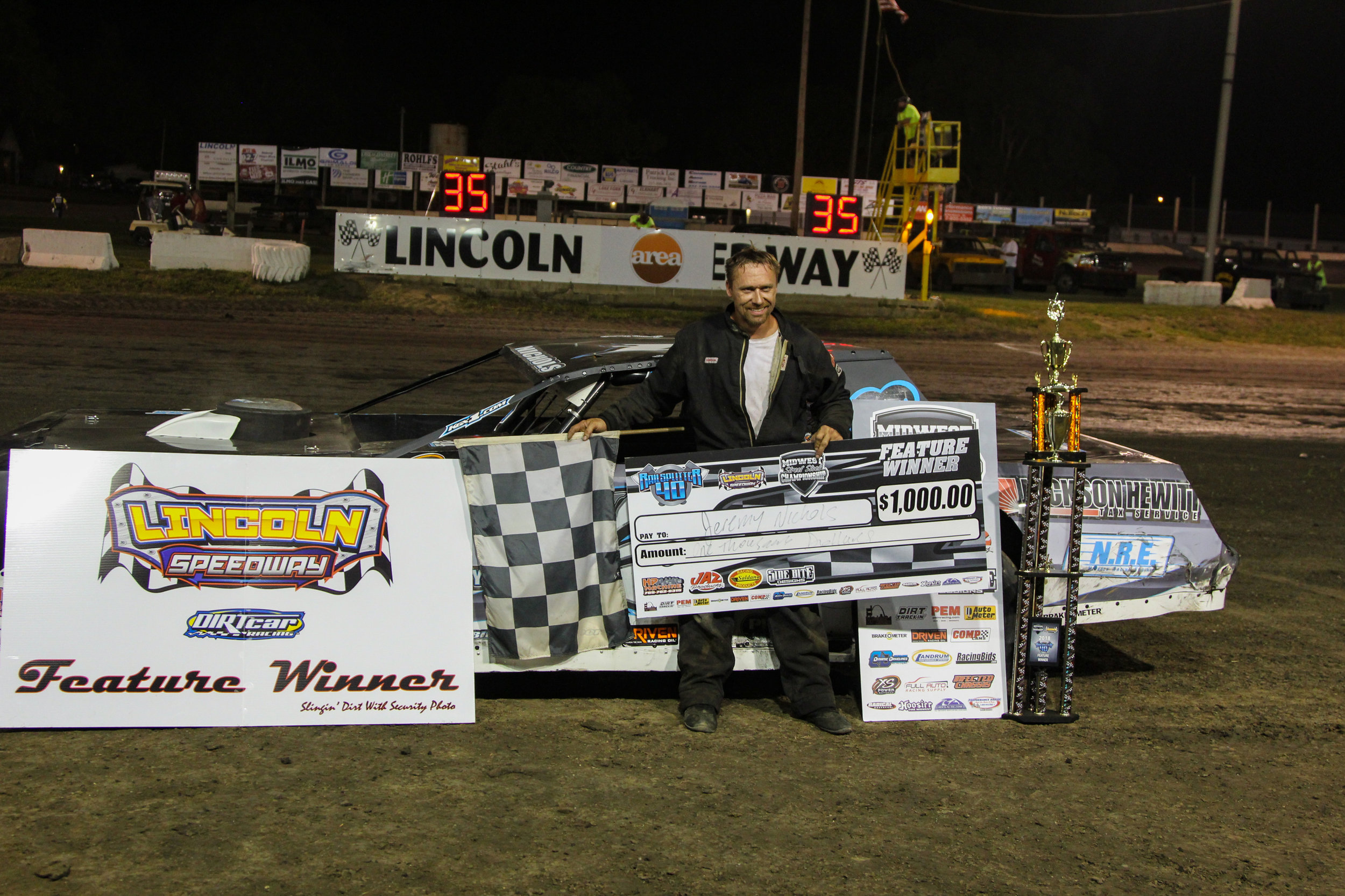 Jeremy Nichols in victory lane after picking up his second Railplitter 40 victory at Lincoln Speedway.  A.E. Blair Photography Photo