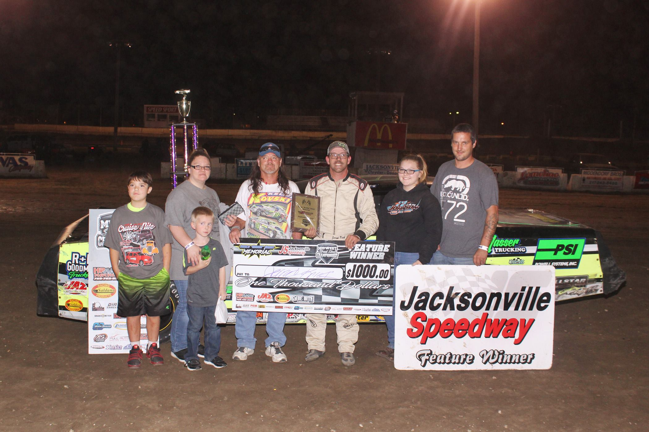 """Jerrad Krick celebrates his first MSSC win with the James """"Bubba"""" Grant family.  Slingin Dirt with Security Photo/Joe Putnam Photo"""