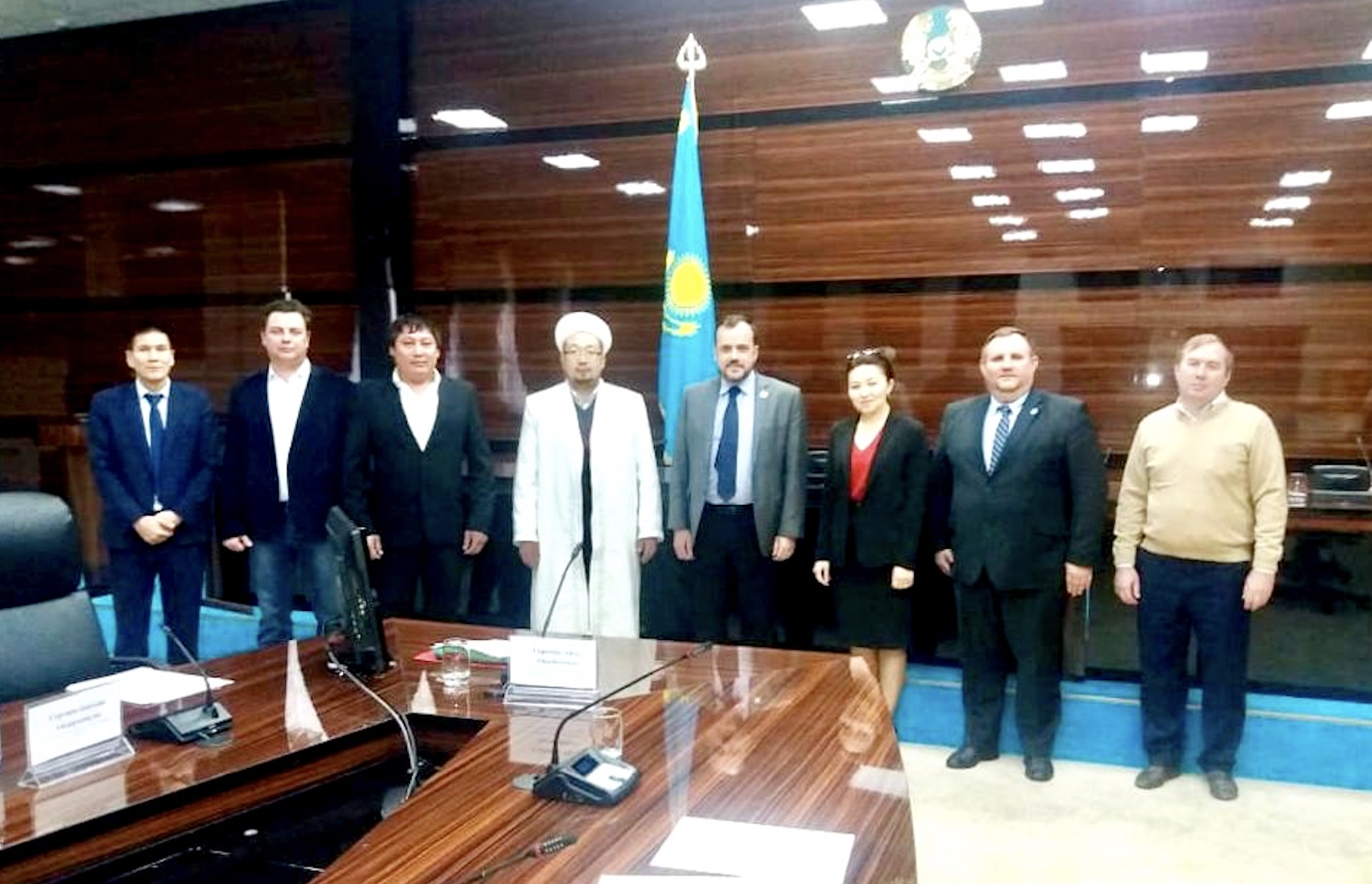 """A PRE ROUNDTABLE EVENT IN SHYMKENT, KAZAKHSTAN  With acute knowledge of the challenging religious climate in the city of Shymkent, Kazakhstan, LYNC successfully spearheaded the first multi-faith roundtable bringing together local government and religious leadership for safe space conversation. It was a substantial step toward multi-faith and government relations as reported by Mr. Kusack.  The Kazakhstan Embassy in US helped LYNC to set up the meeting and invite the government officials and local imams. The government was represented by Aigul Sarseyeva, Deputy Head of the Department of Internal Policy and Head of the Department of Religious Affairs of Shymkent. There were two local imams and three evangelical pastors, president for AROK Aleksandr Klyushev and three mayor assistances.  The agenda was to learn and discuss the following topics:  - The history of relations between Kazakh Embassy and IRF Roundtable in Washington DC, including previous IRFR delegation visits and the conferences organized by IGE  - Declaration VI Congress of the Leaders of the World and Traditional Religious with the emphasis on religious literacy and tolerance.  - Possible larger roundtable with more diverse religious groups in the middle of 2019. The socially important or educational project that would include government and different religious communities would follow the roundtable.  Mr. Kusack maintained a warmth and openness in the meeting and encouraged participants to do the same. One of the imams even said, """"I never had any concerns regarding the Baptist church that is next to my mosque."""" Ironically though, he never talks to the pastor of this church which underlined the necessity of our roundtable.  As a result of the roundtable, it was decided to continue the dialogue between Muslims and Christians and find what can be done together, including with the government."""
