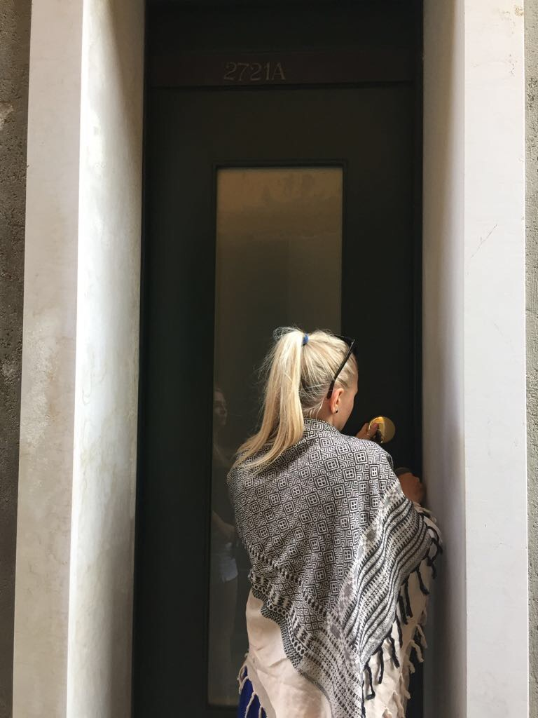 This was the door to our Venice Airbnb. The keys in Europe are giant and old fashioned, but can be tricky :) Wearing my handy big scarf.