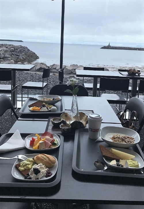 First meal in Iceland with the view of the Atlantic Ocean