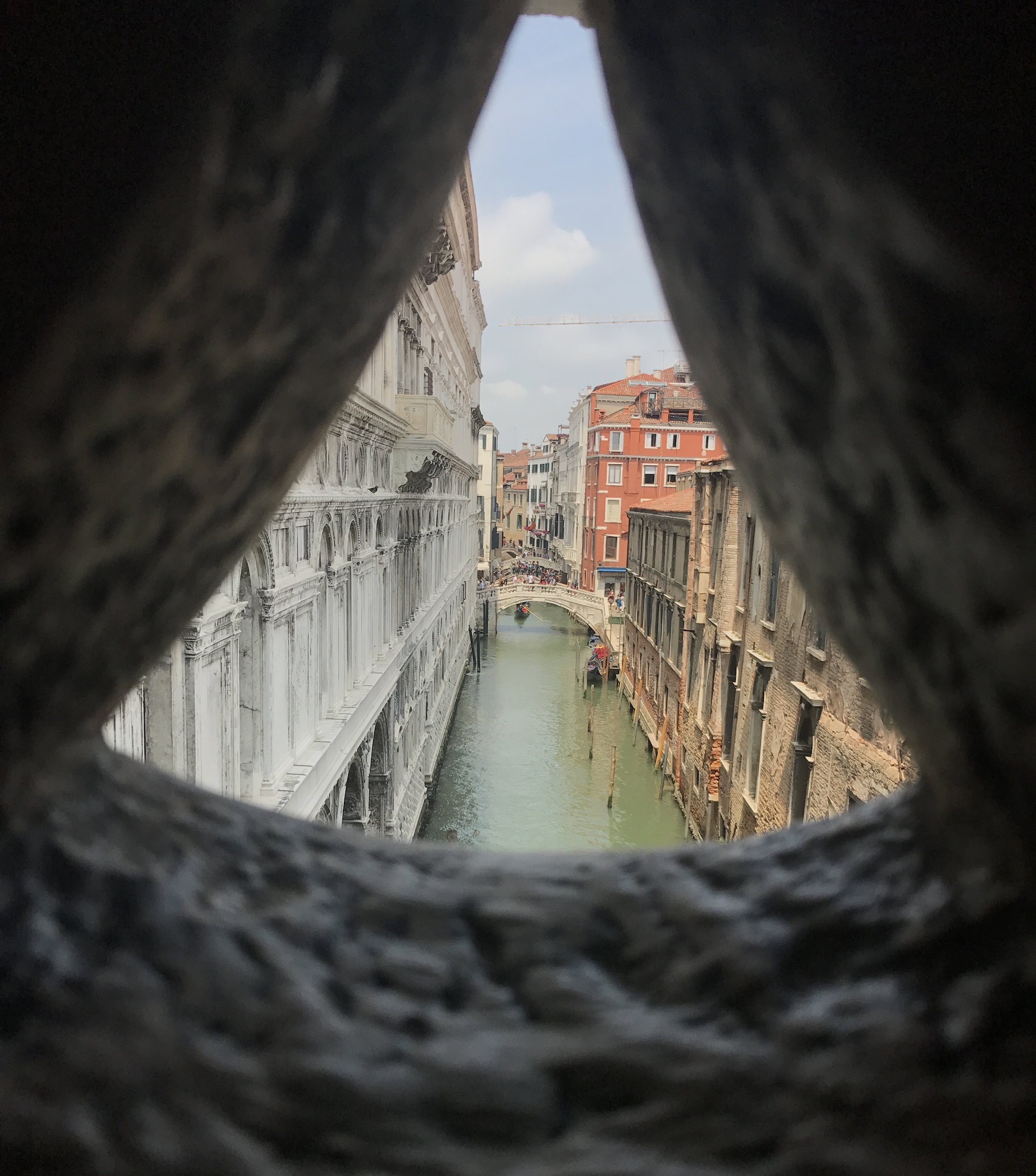 This is the view you get peeking through the designs in the Bridge of Sighs window