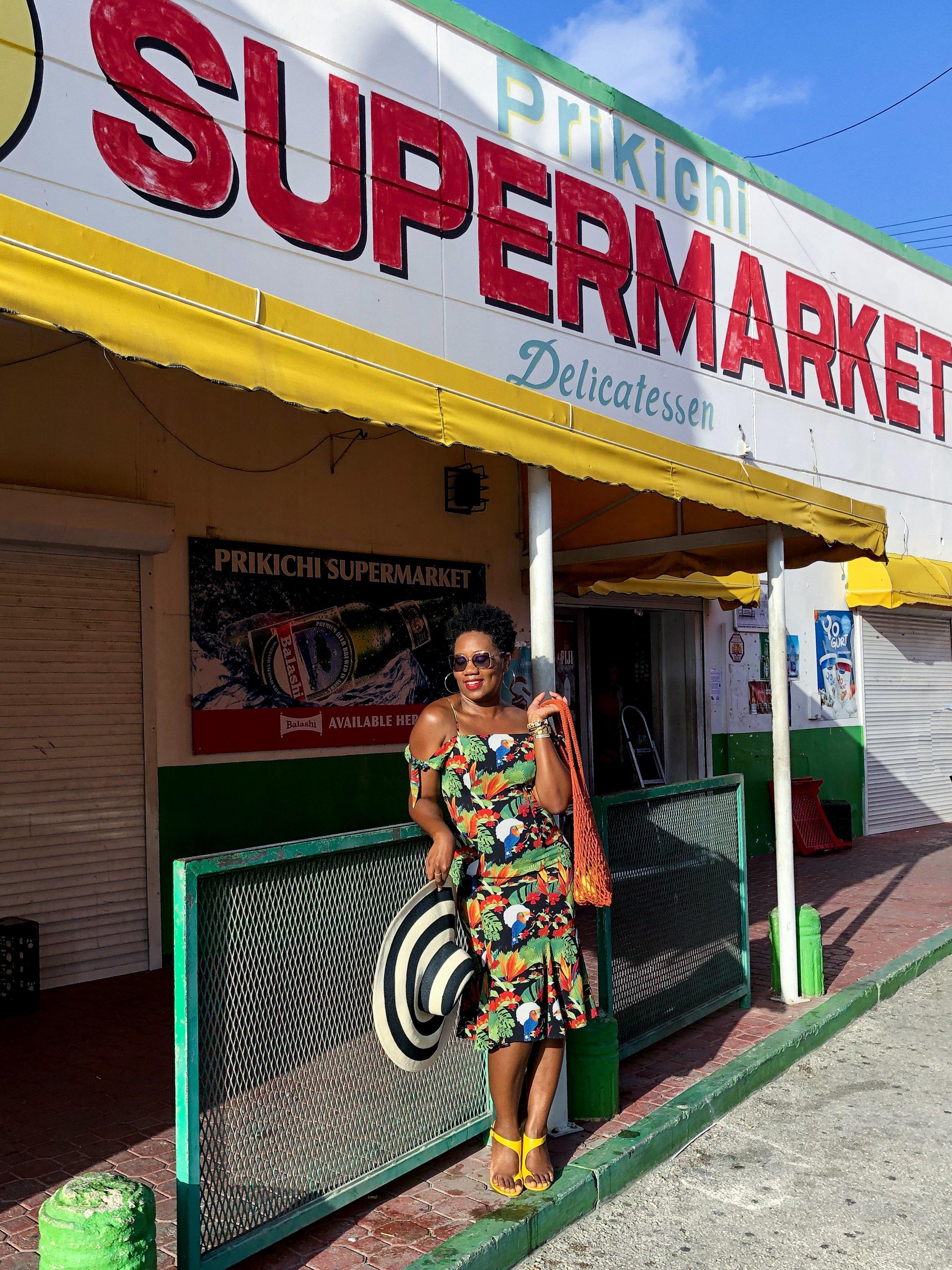 Shop my look:   Black Tropical Print Dress     Crocheted Handbag       Striped Straw Hat       Yellow Sandals