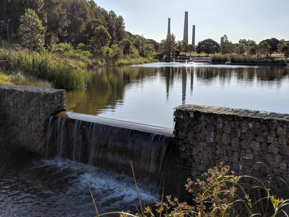Gabions holding back water with cascading flows providing soothing sounds. Note the iconic brick kiln chimneys in the background