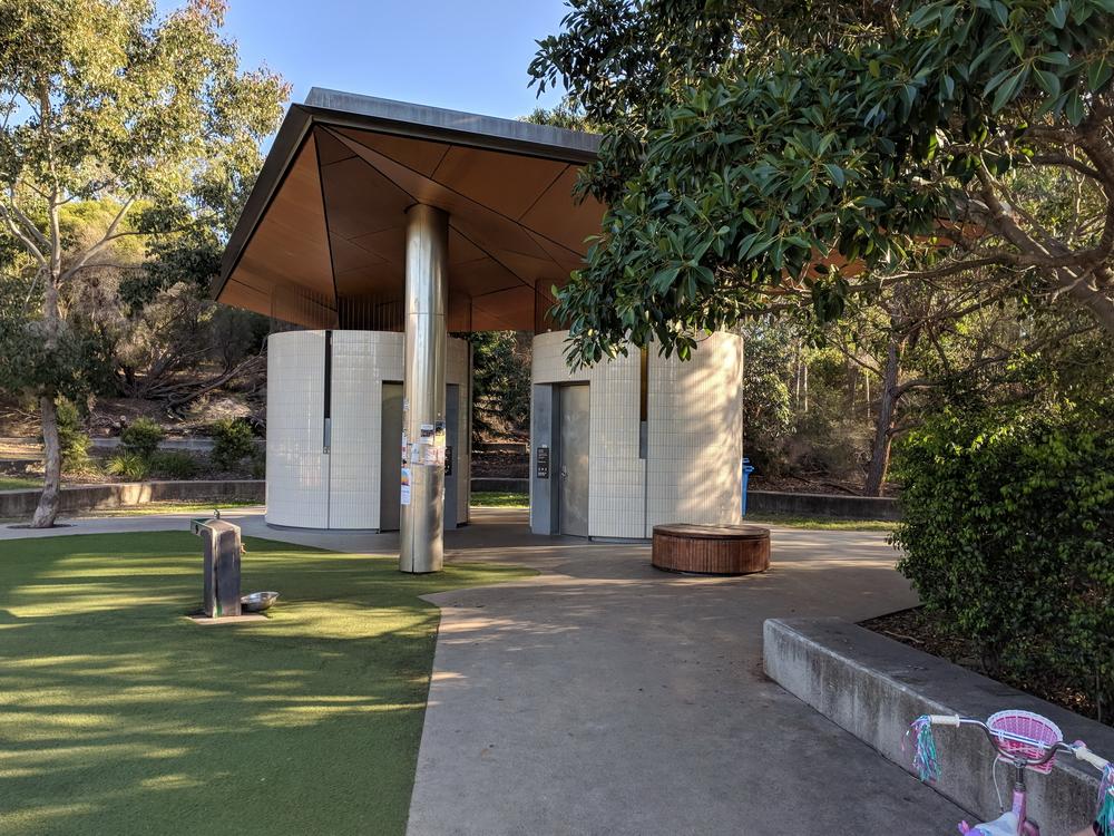 Modern toilet facilities adjacent to playground