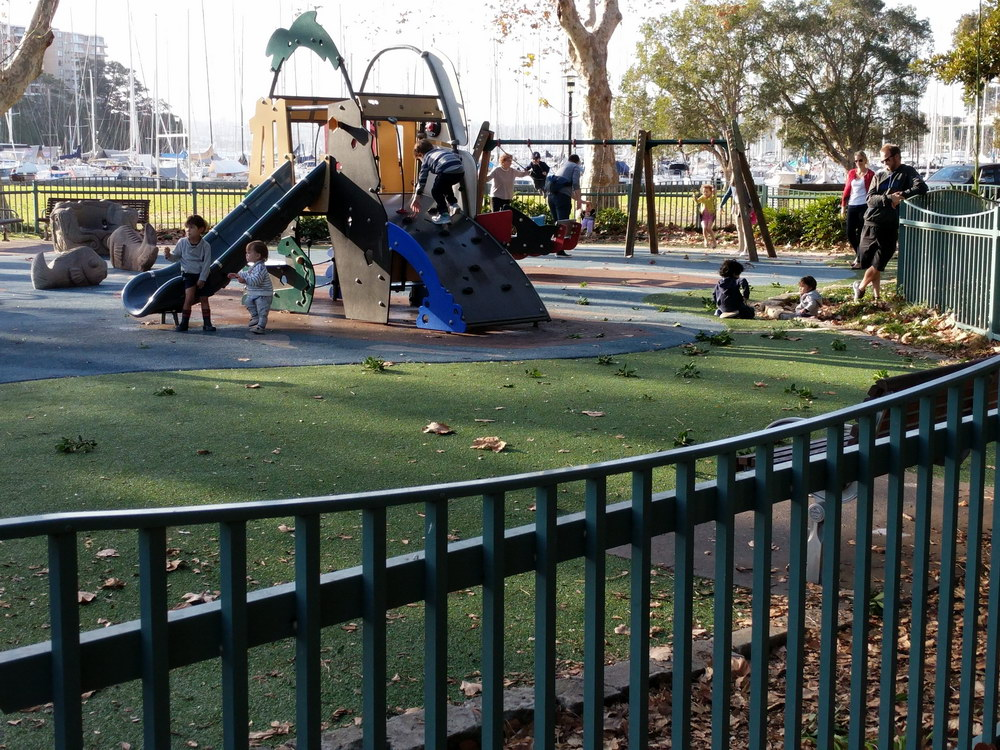 Close-up of parts of the playground with yacht club in the background