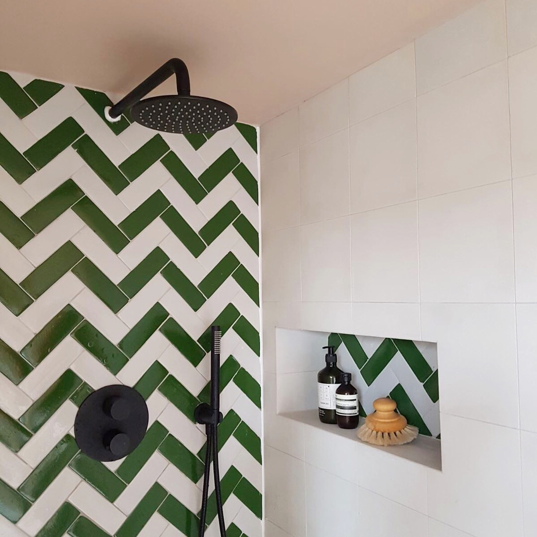 Tiles -  Bert & May  (the Green and White glazed Bejmat and the Brighton Stone white encaustic)  Black Shower -  Lusso Stone   Accessories from  Aesop  and  Arket