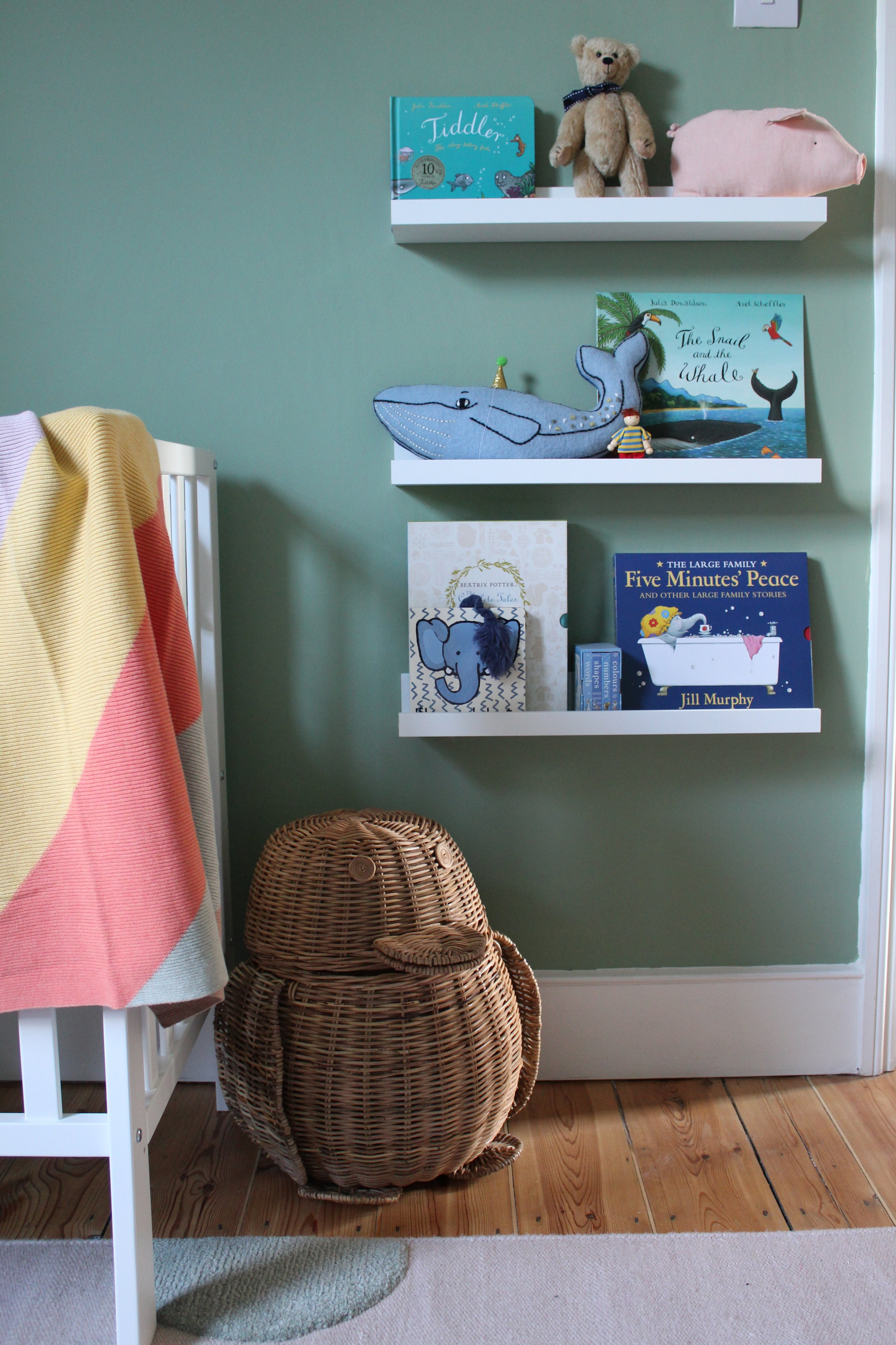 The walls are painted in Farrow & Ball's Breakfast Room Green which creates feels fun and lively enough to hold the colourful accessories, whilst also creating a certain serenity in the room. The wicker penguin storage basket is from Zara Home - I mean, how could I resist!? The book shelving is from Ikea and the baby blanket is Mama's & Papa's.