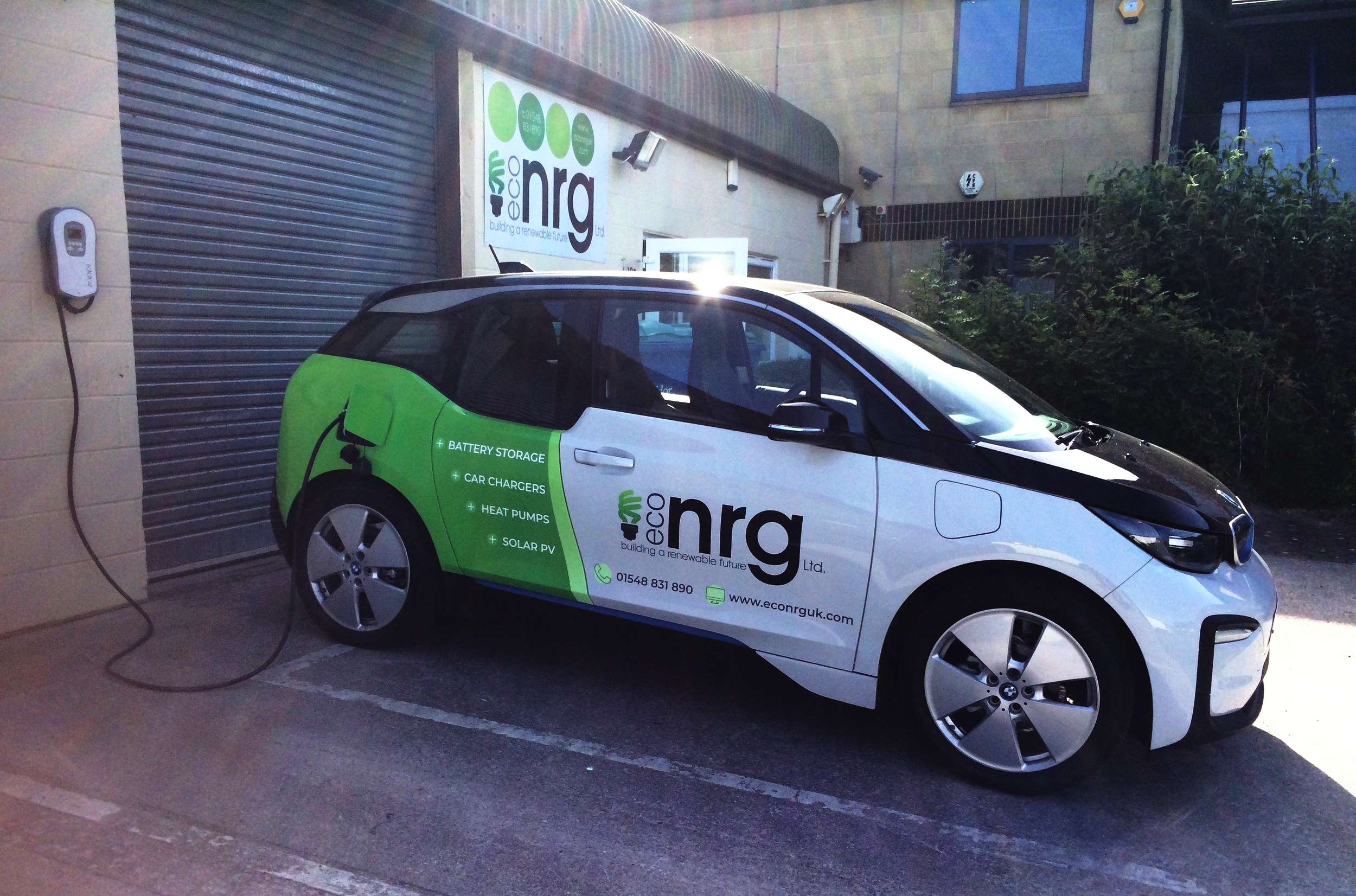 Our new, eco-friendly BMW i3, charging in the summer sun