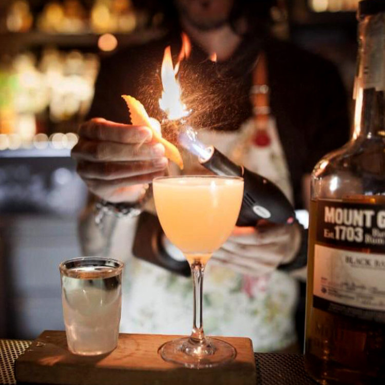 Our Rum Game is on Fire!    Mount Gay Rum  cocktails crafted by master mixologist  Christiano Souza  of  Saltie Girl  to pair perfectly with lamb and a guided tasting of Mount Gay's finest and rarest 1703 rum, a blend hand selected by Master Blender Alan Smith.