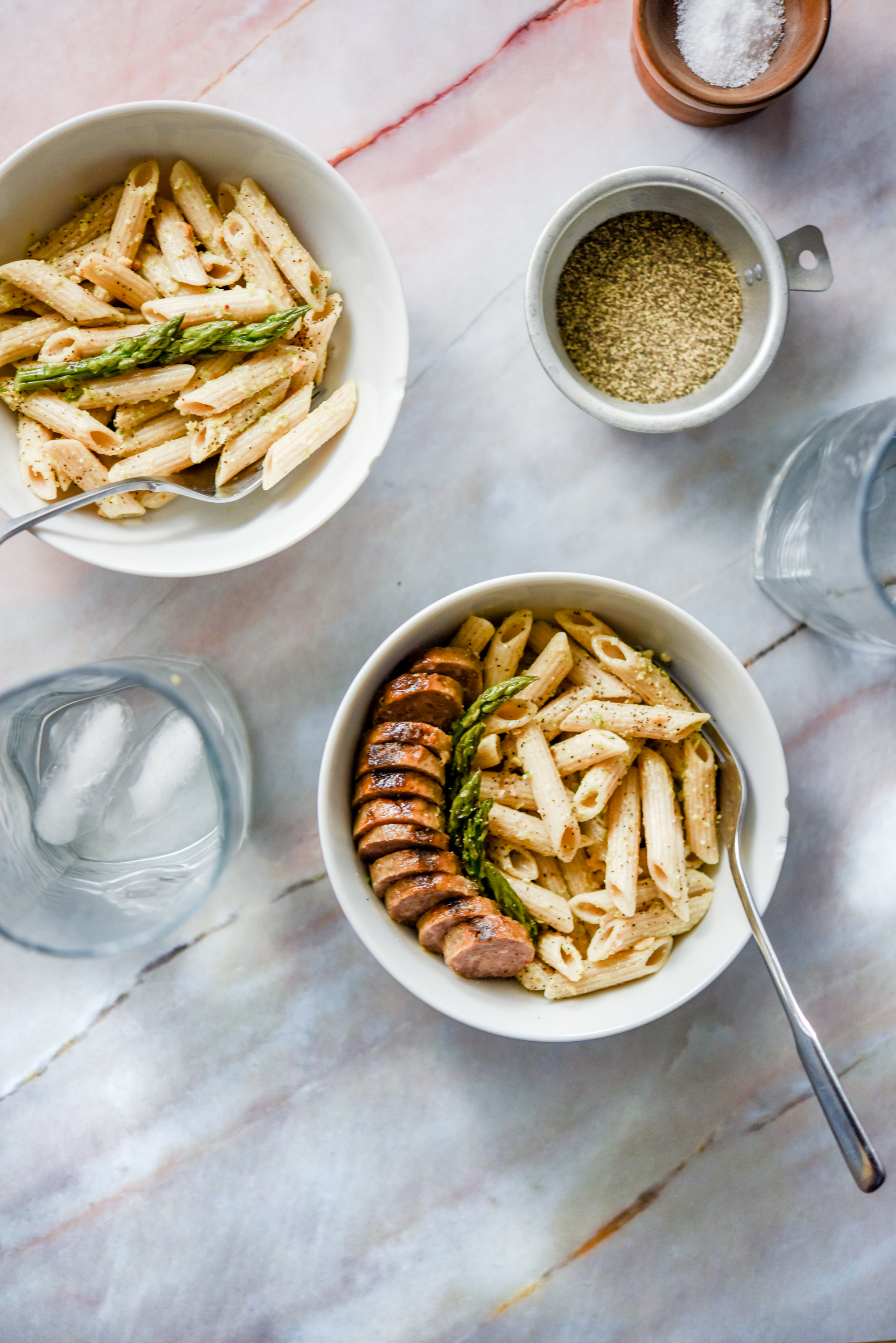 asparagus-pesto-penne-pasta-with-sausage-marble-background-Raleigh-food-photographer.jpg