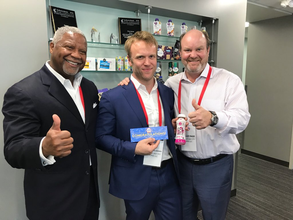 Keith Rodgers, YUMIX VP of Sales, Alex Garner, YUMIX founder and CEO, and Phillip Page, YUMIX President and CFO, celebrate at Walmart HQ in Bentonville, Arkansas after scoring a deal at Walmart's 2018 Open Call event / Photo courtesy of Walmart
