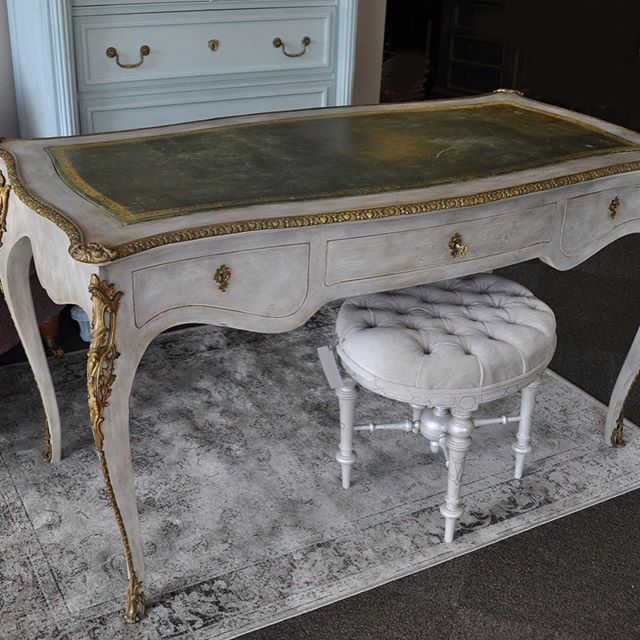 """Next up, a beautiful French desk commissioned by a client...the """"before"""" is last. Done in Annie Sloan greys, a splash of green to pull in the leather top and dark waxes. The bazillion nails and screws of the ormolu nearly did me in 😱 But I'm happy with the result 👍"""