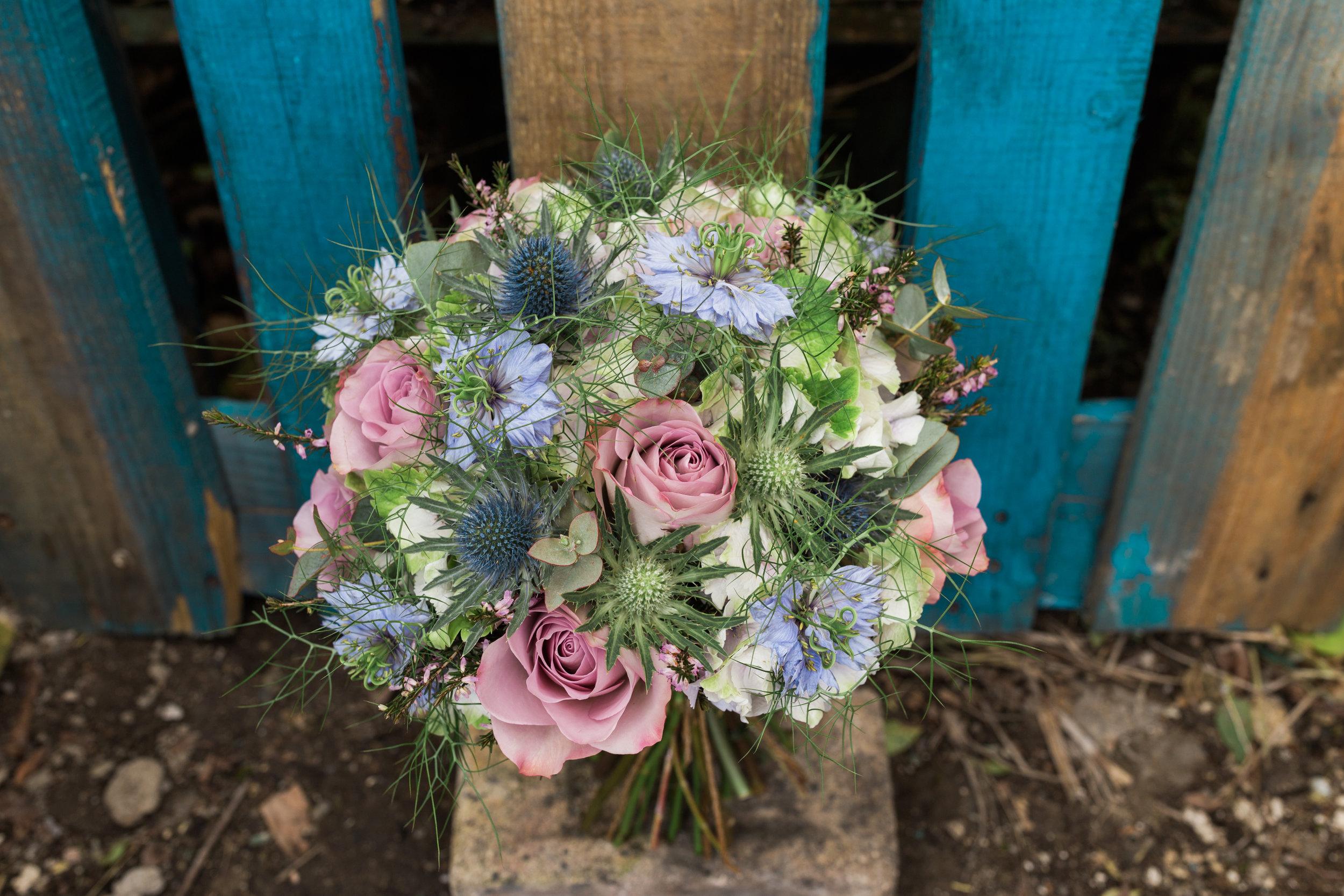 A very Scottish themed bouquet with Memory Lane roses, eryngium, heather, nigella, hydrangea & eucalyptus.