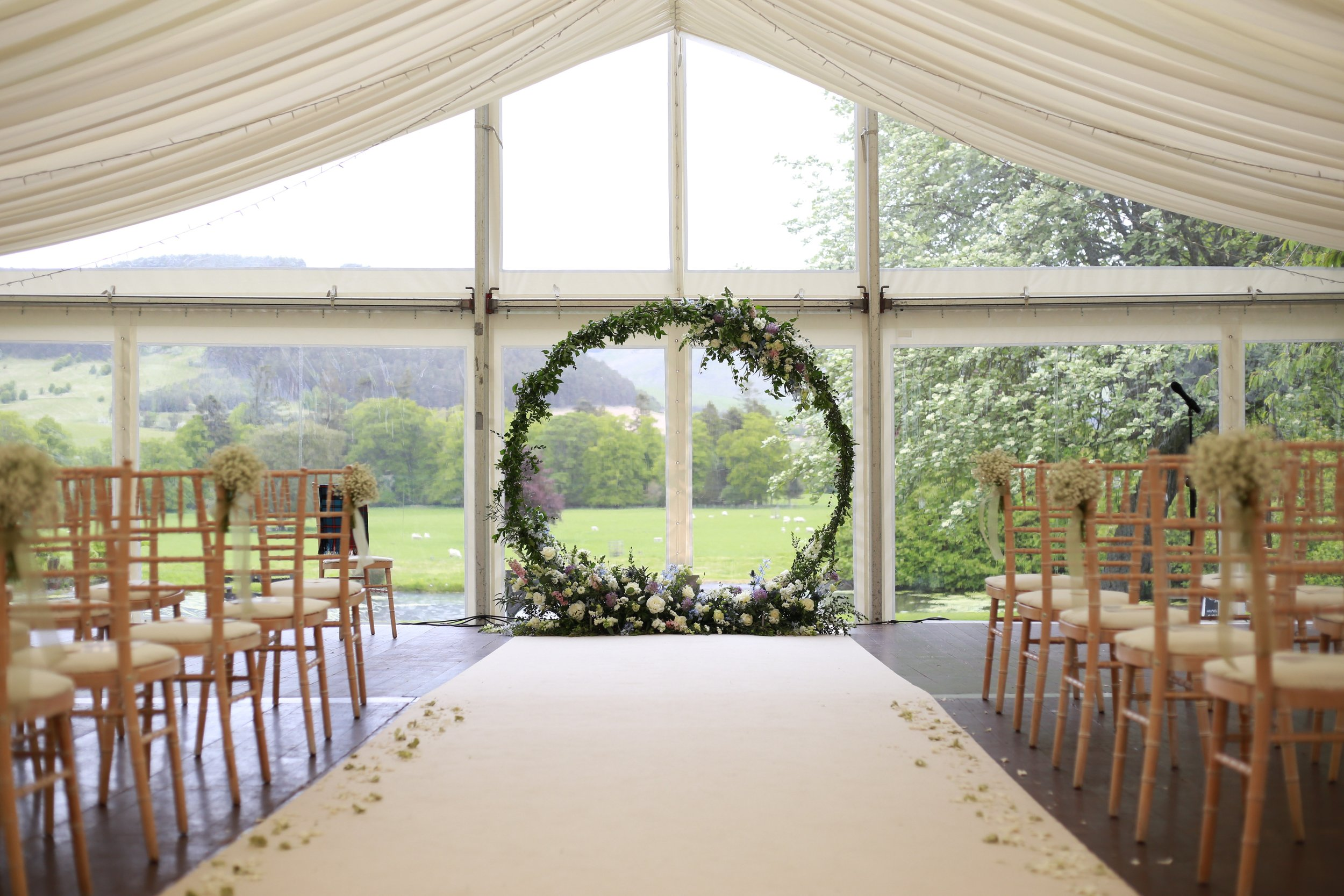 A modern twist on a floral arch, the moon gate! At Kailzie Gardens, Peebles | Photographed by Stems.