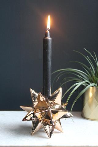 Star Candle Holder £14.95 -  A ceramic star candle holder finished in a copper plating.   www.violetandthistle.com