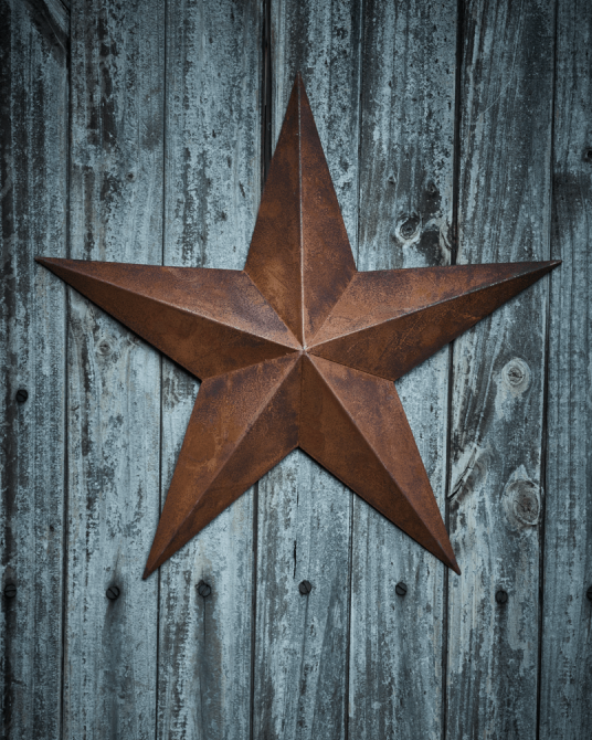 Rusty Star decoration - £20.00  Perfect for mounting on an outside wall or propping on any surface -H 49 x W 49 X D 12cm   www.coxandcox.co.uk