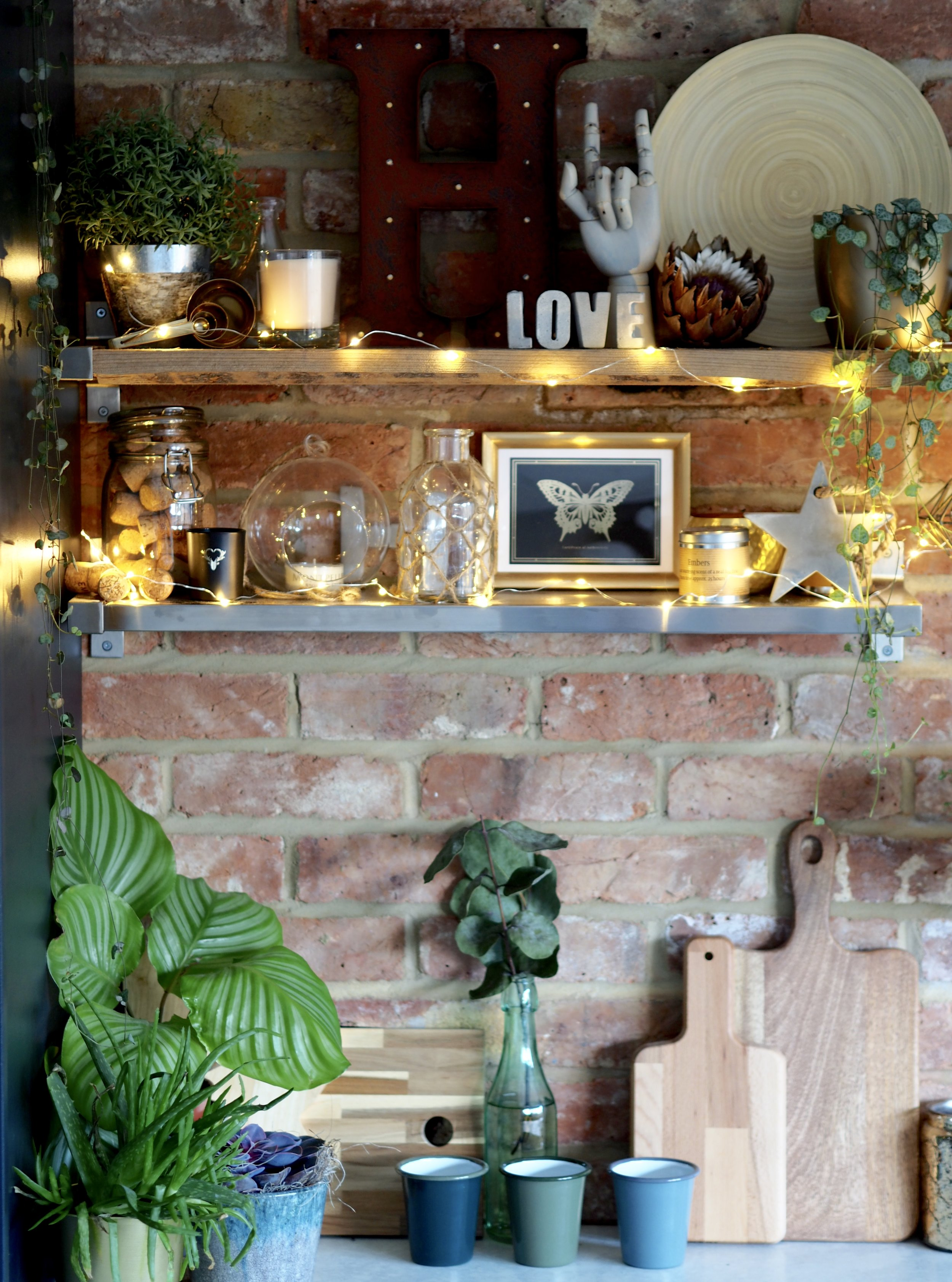 The fairy lights certainly make all the things I love on my kitchen shelves stand out more......