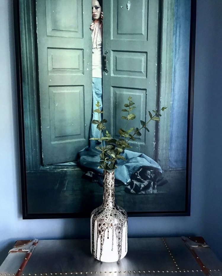 Just one of the beautiful prints in Beth's home...... 'Lady Behind Doors' -   coachhouse.com