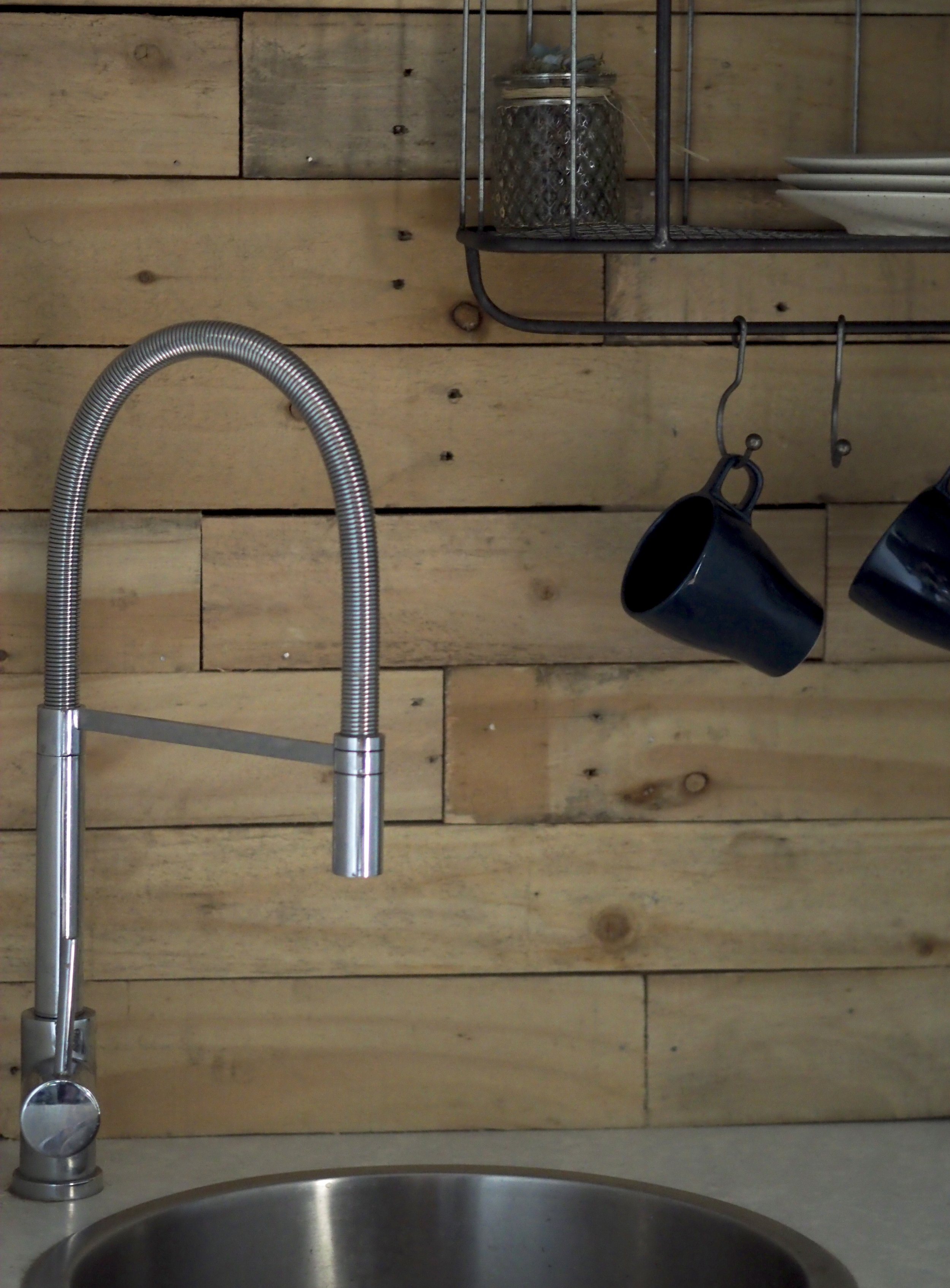 A long hose spray tap is ideal in a washing up area.......