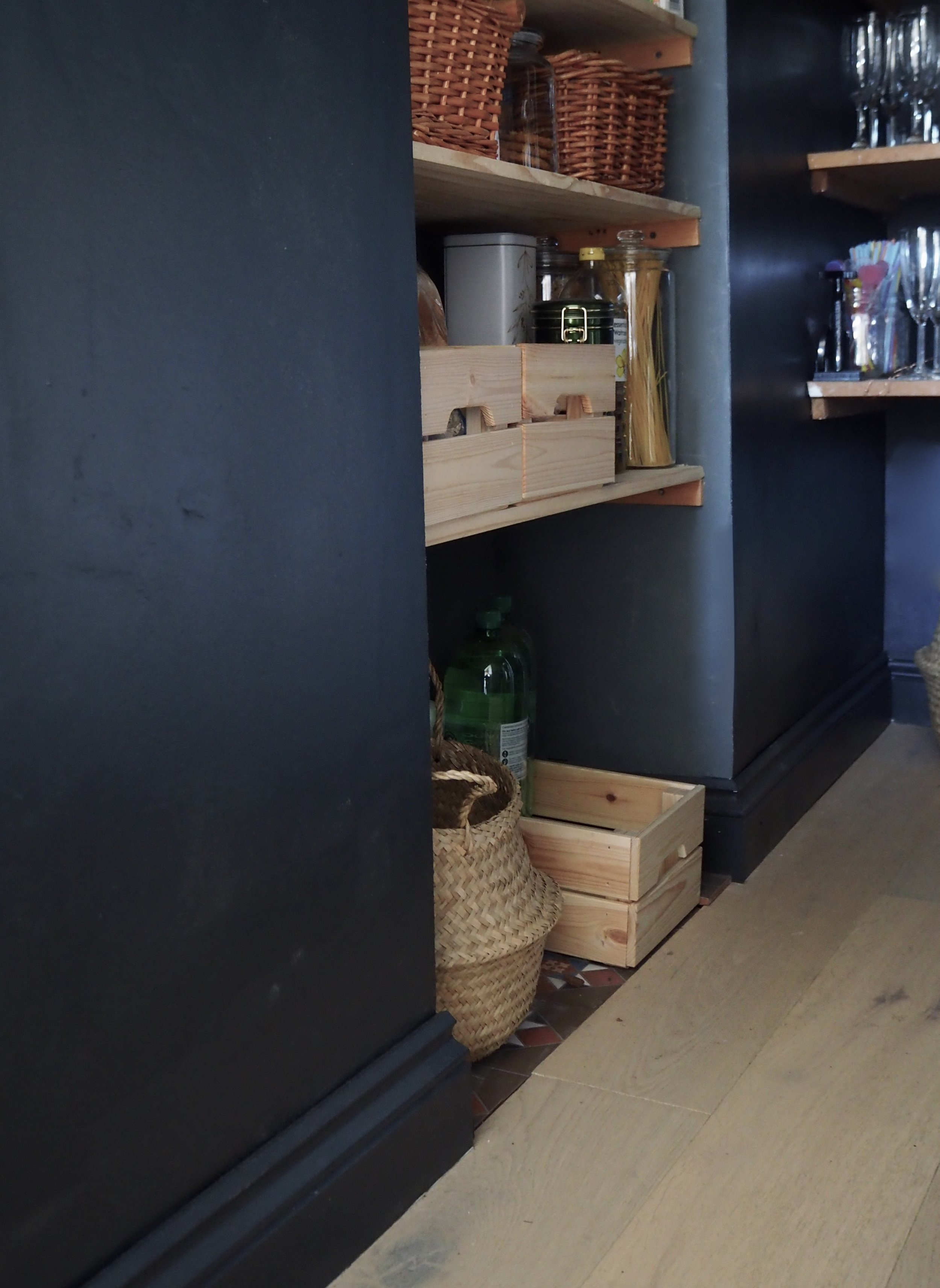 Dark walls and skirting make the walls appear taller and add impact which I love in a small room.......