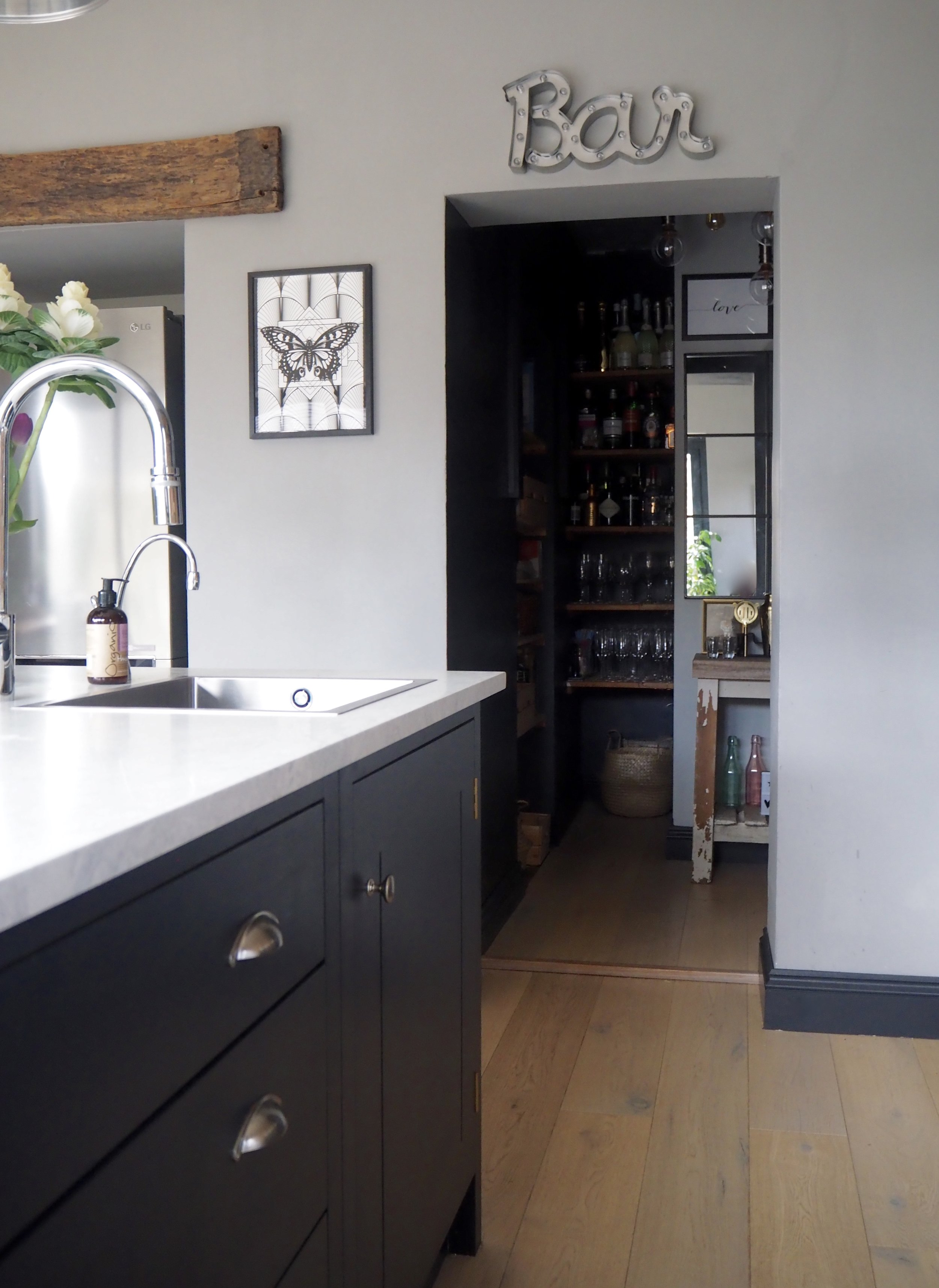 The wall of 'Railings' as you go into the pantry is the same colour as the kitchen units and makes the rooms flow into each other as well as adding a statement against the pale grey walls at the entrance......