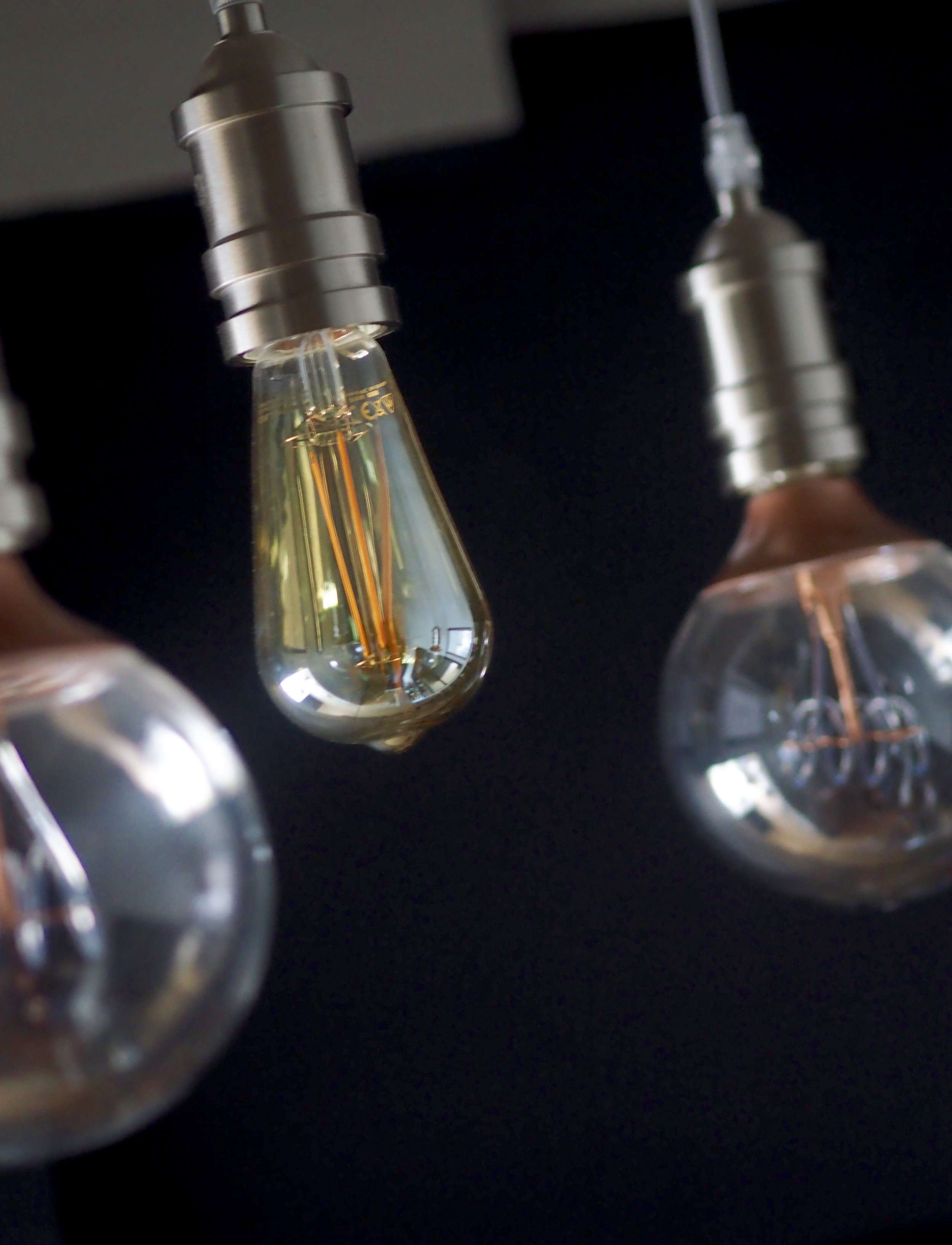 Different coloured and wattage bulbs add interest to a multi bulb light fitting.......