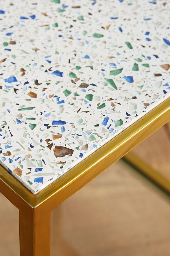 ....... close up of the gold effect metal frame for the terrazzo style table duo from Anthropologie...... two trends in one!