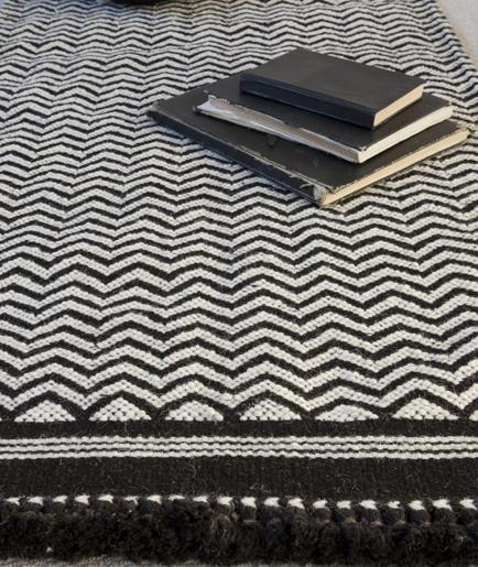 I love this black herringbone hand woven rug - £195   www.charcoalandgrey.com