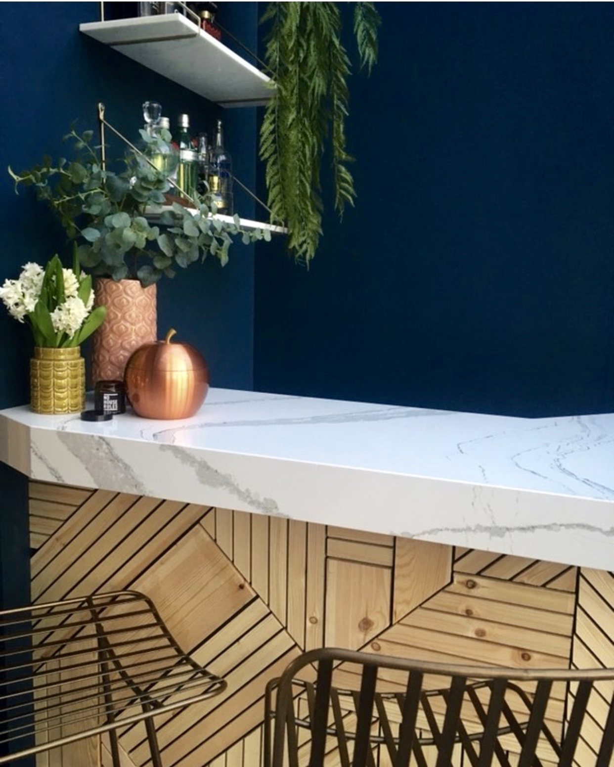 I love the classic marble counter top Donna has added against the geometric wood pattern on the bar....  Midas bar stools Rockett st George ....... Hague Blue wall paint   Farrow & Ball