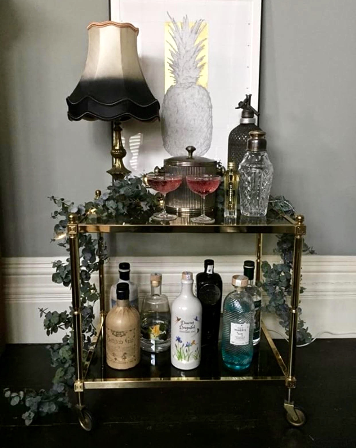 Estelle has added eucalyptus to her gold bar trolley as a beautiful feature, I do love this pretty home bar.....    @savageinteriors