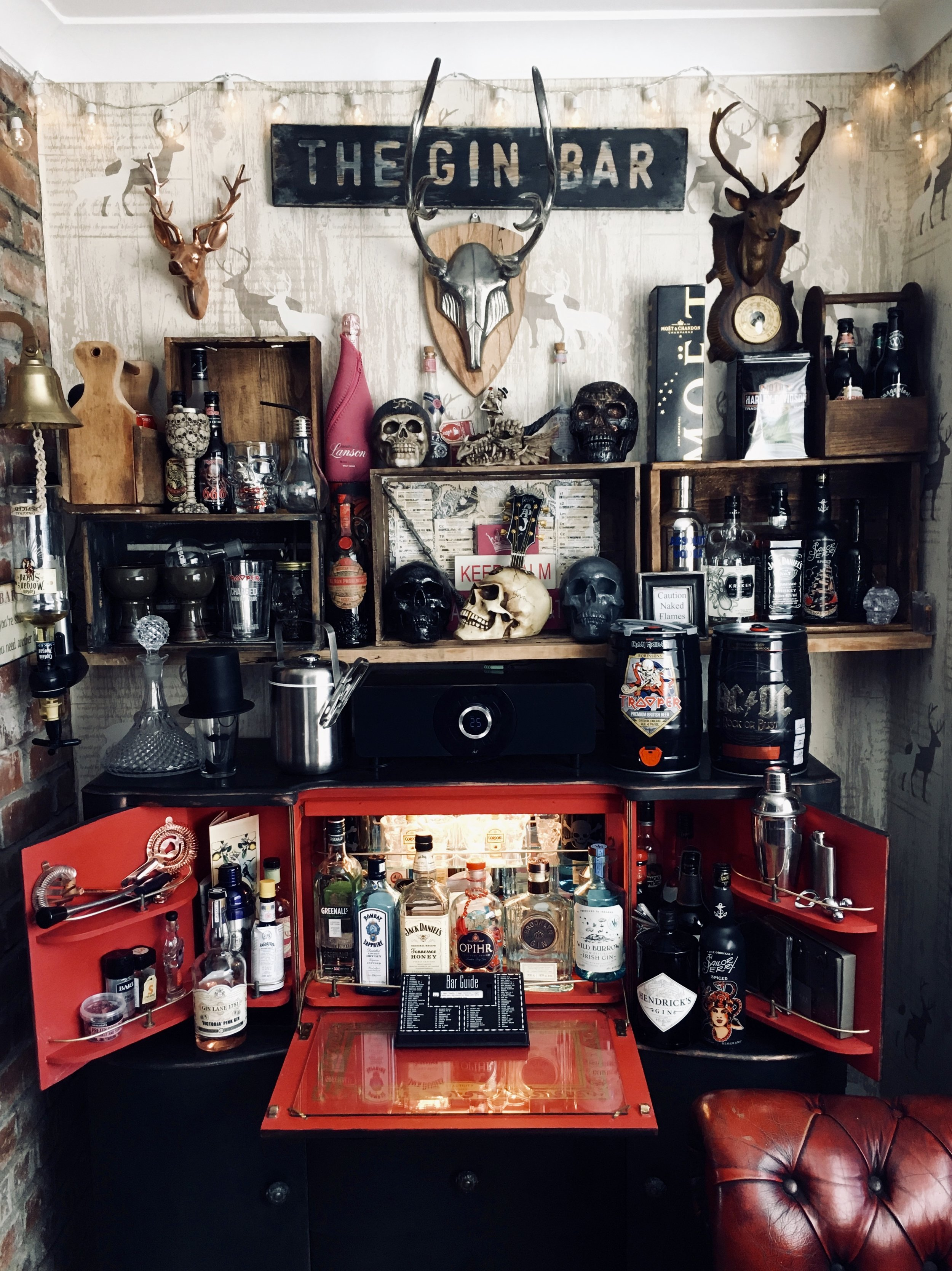 Kelly's bar area in her home even has its own name 'The Dirty Dog'..... She bought a cocktail cabinet and painted the inside red and got the lights working again to make this fabulously gothic home bar area    @tyambyth