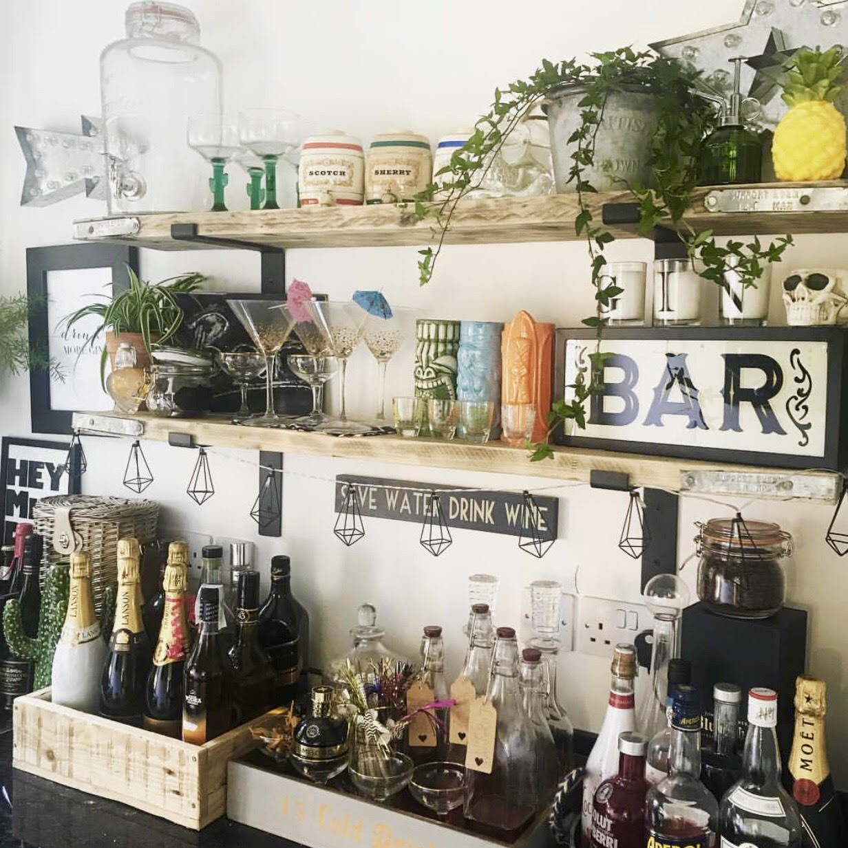 Zara has used rustic wood shelves and crates for the glasses and to store the booze in her bar area..... Add to this lighting, plants and accessories and you have a fabulous modern rustic home bar!    @zaraplus3