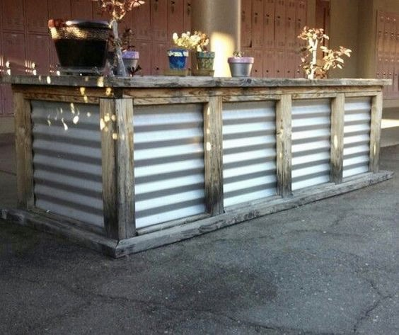 This reclaimed wood and corrugated iron bar is another Pinterest find...... I think the industrial look of this outside bar is great!
