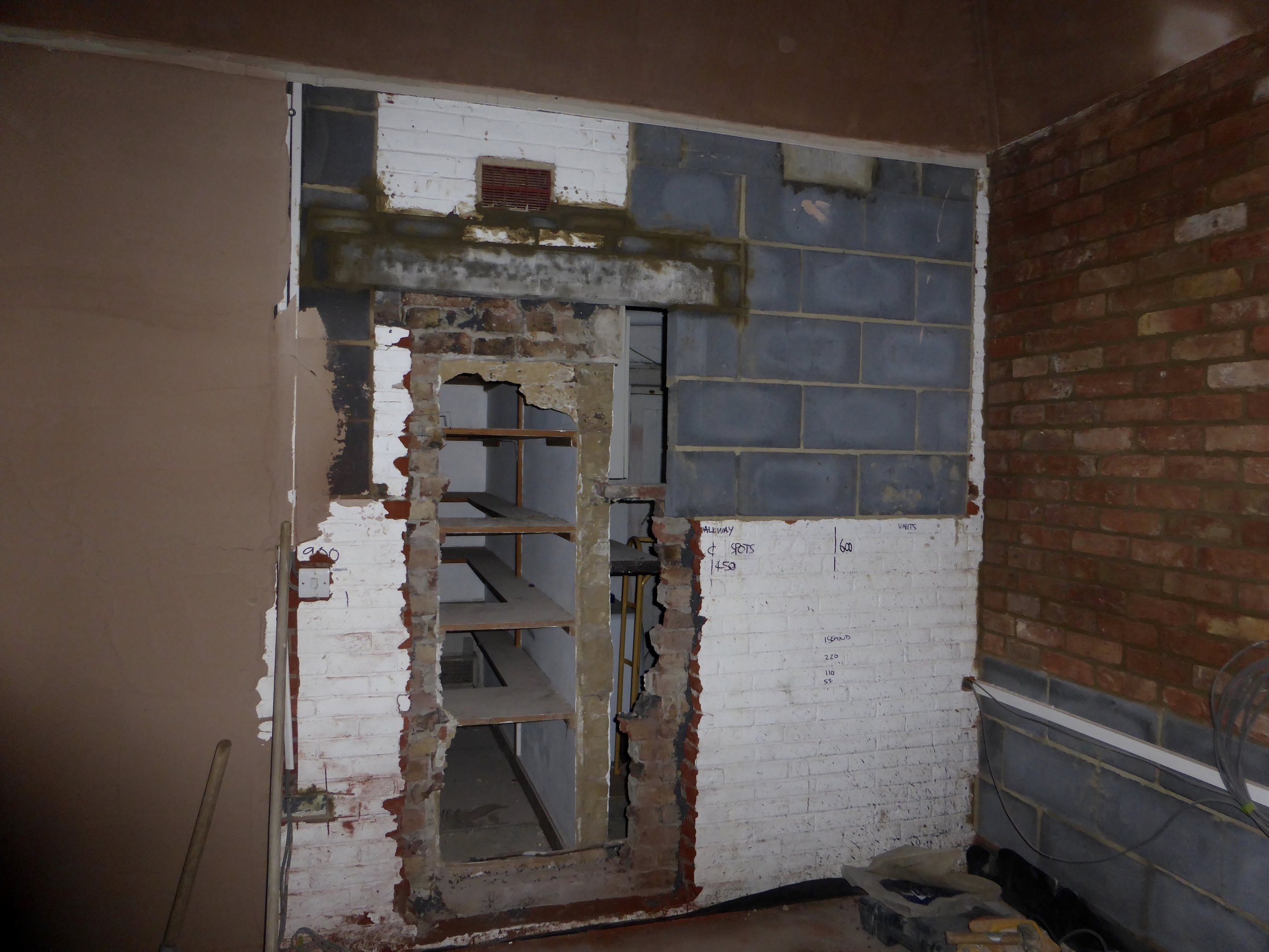 Knocking through to what will be the pantry housing a larder, home bar area and another sink and the dishwasher......