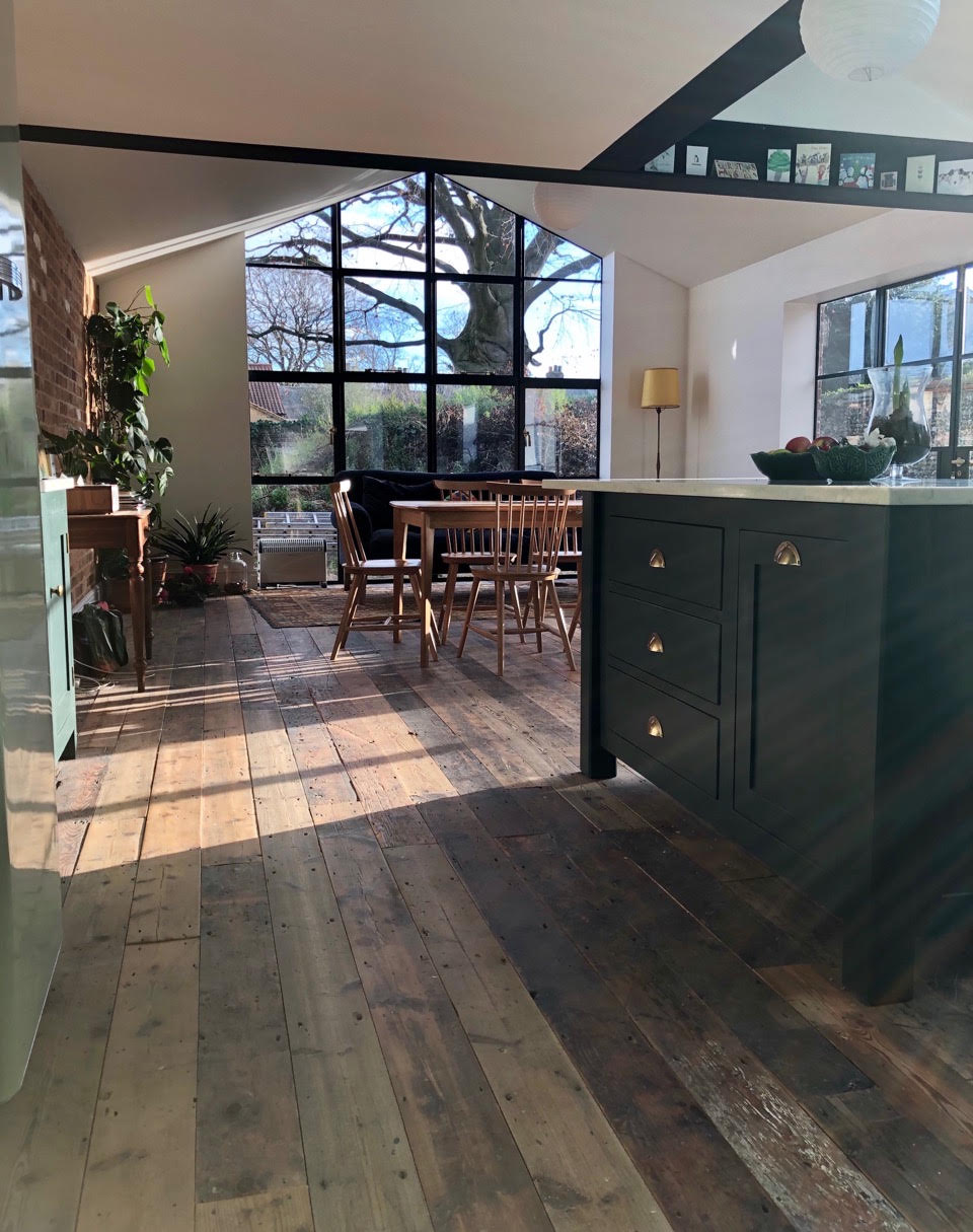 The floorboards in Clare's kitchen are reclaimed pine boards which are over 100 years old- i love them!….. Oh and those windows…. Just fabulous!