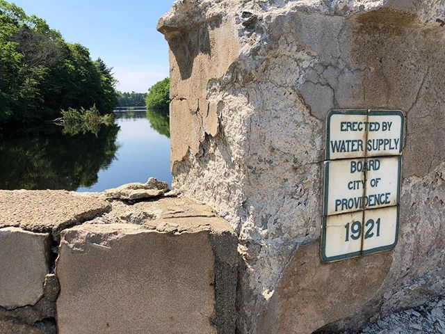 Erected nearly 100 years ago, the corroding southern side wall of the Horseshoe Dam Bridge on Danielson Pike, provides insight to priorities - watershed land over infrastructure.