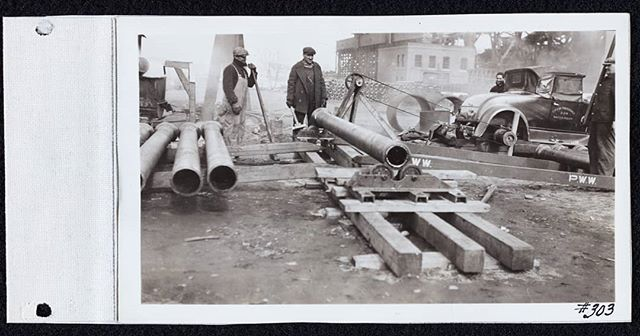 Pictured is an apparatus for spinning Bitumastic Enamel Coating onto the interior of pipes, pipes that will be used on the reservoir. On to the right the photo shows that the apparatus is made out of a City of Providence Water Maintenance car that has been partially de-constructed.