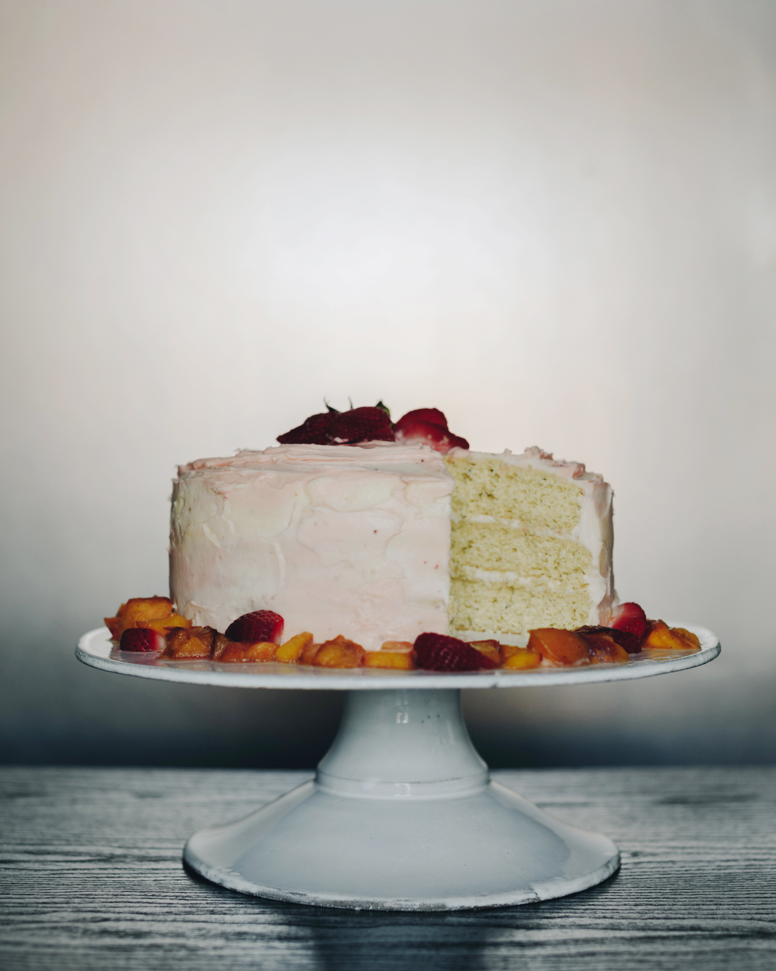 spicy peach cake with strawberry cream cheese icing