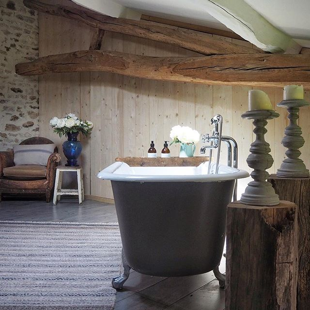 """Morning! I need your help my lovely insta massive and it's interiors related so hopefully you'll be able to assist! I've put up a partition in the bathroom here in France and I've done this for a couple of reasons. Firstly to create a storage area for our """"stuff"""" and secondly to make the bathroom more cosy. It looks great and I'm happy with it but I just wondered if maybe I should paint it or stain it? I've put a poll on my stories over on @vintagecuratorinteriors so if you have time can you go and vote. Or let me know what you think by commenting below. Thanks in advance! #bathroomdecor #bathroomrenovation #bathroomsofinstagram #bathroomstyling #vintagebathroom #freestandingbath #tubtime #standoutstyling #reclaimed #cornerofmyhome #myinteriorvibe #howyouhome #myinteriorstyle #brocantestyle #frenchholidayhome #bathboard #bathroominspo #bhghome #ekbbhome #bestofinterior #interior_delux #interiormilk #bathroomsofinstagram #modernrusticdecor #interiorepitome #interieurinspiratie #myconsideredhome #myrustic"""