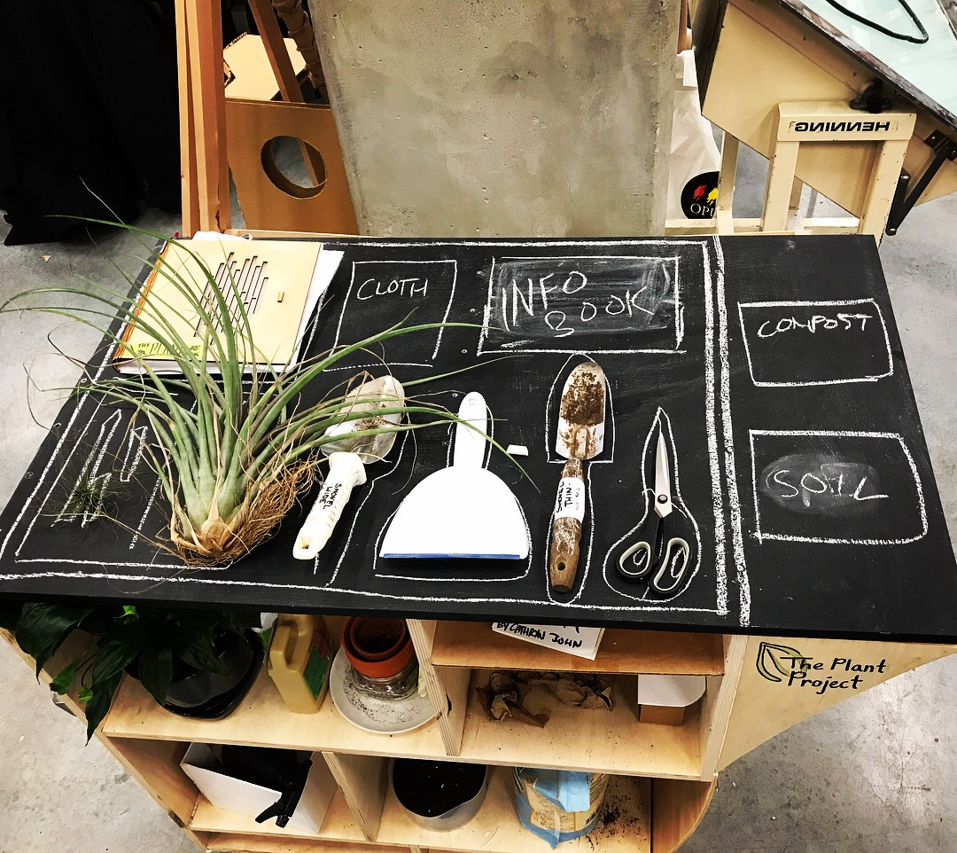 Chalkboard Top - After my final critique for the first semester I decided to get rid of the backing and add in a chalkboard top. The top of it became a really interactive part of the project. It drew people in and got the community excited about participating in more plant based activities.