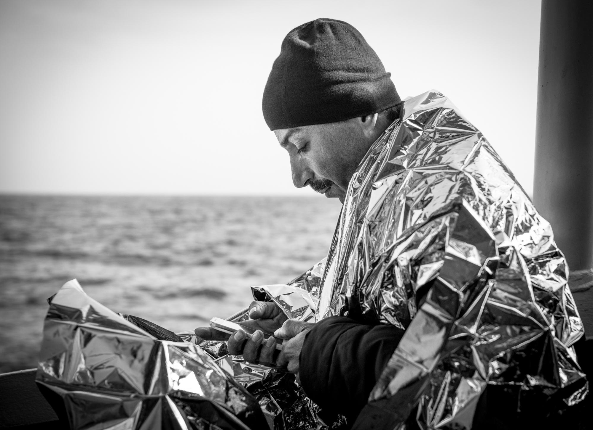 Syrian man iPhone.jpg