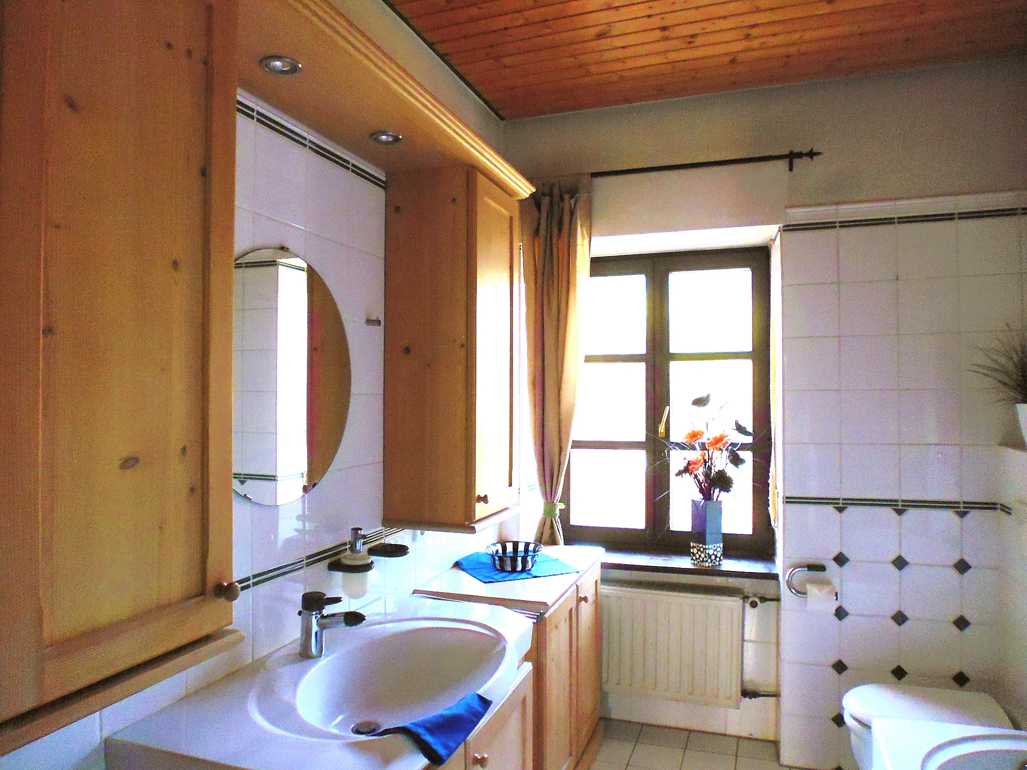 The largest bathroom features a bathtub and shower