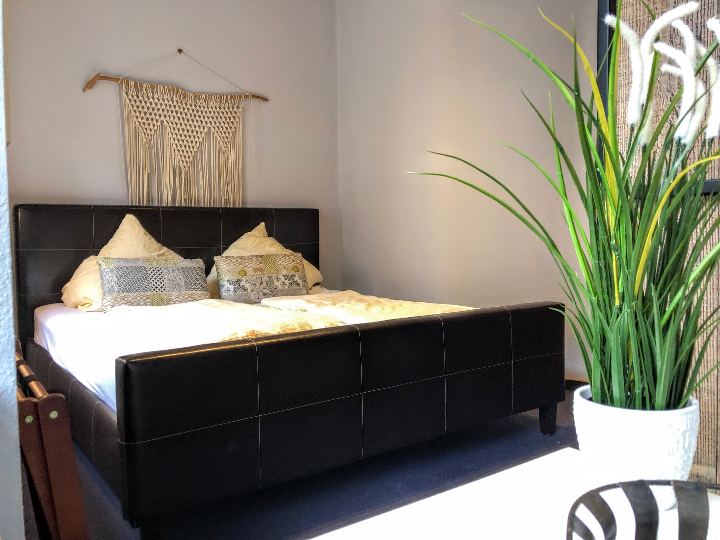 The second bedroom also features a large, comfortable bed