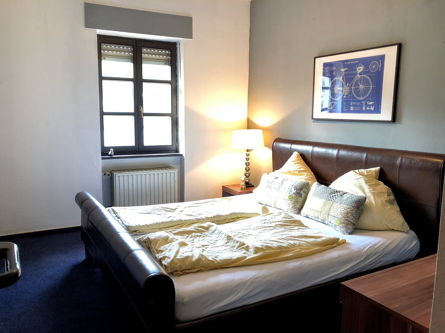 This bedroom has a large, comfortable bed and beautiful view of the river