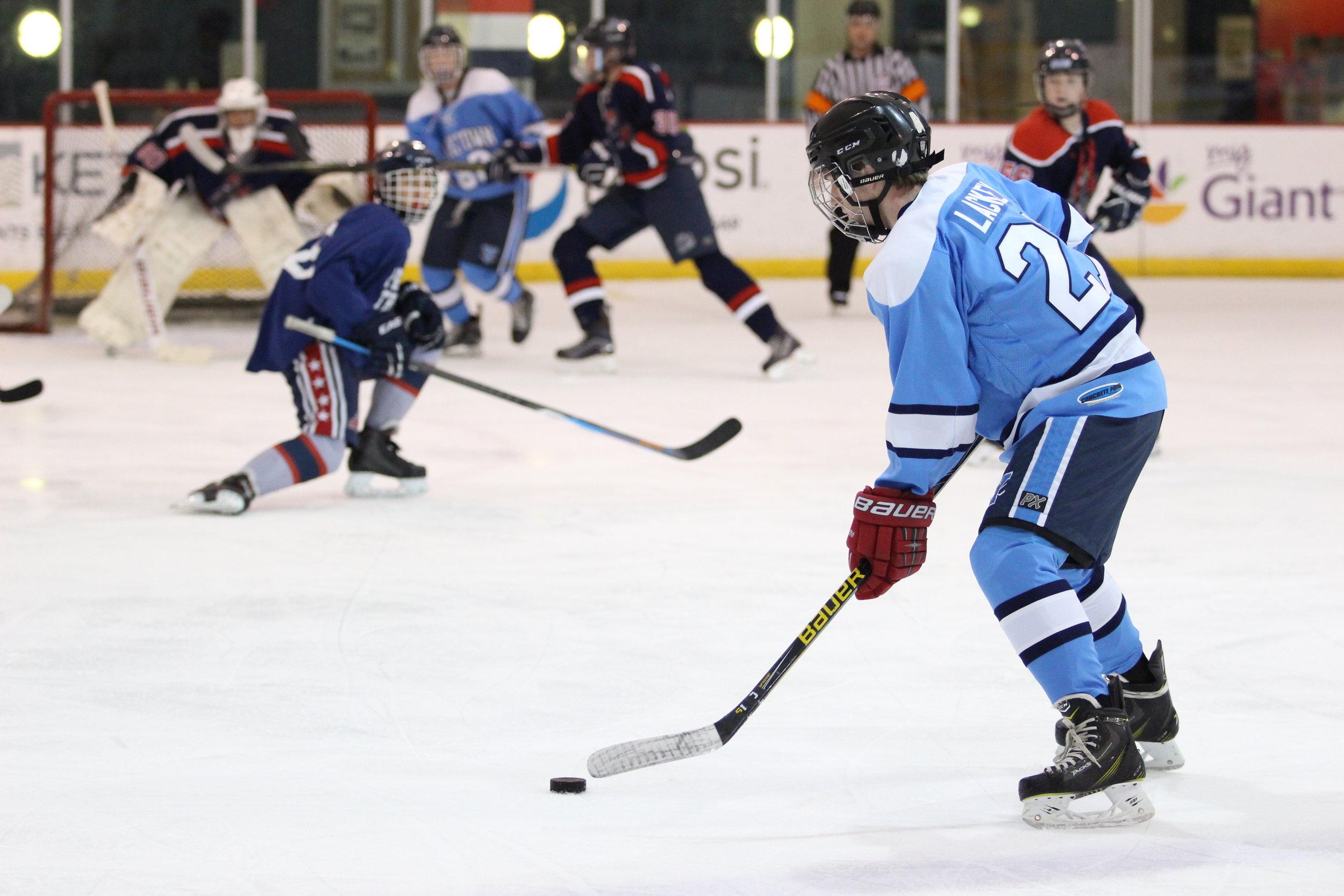 IMG_8864 LAckey taking a shot - good action.JPG