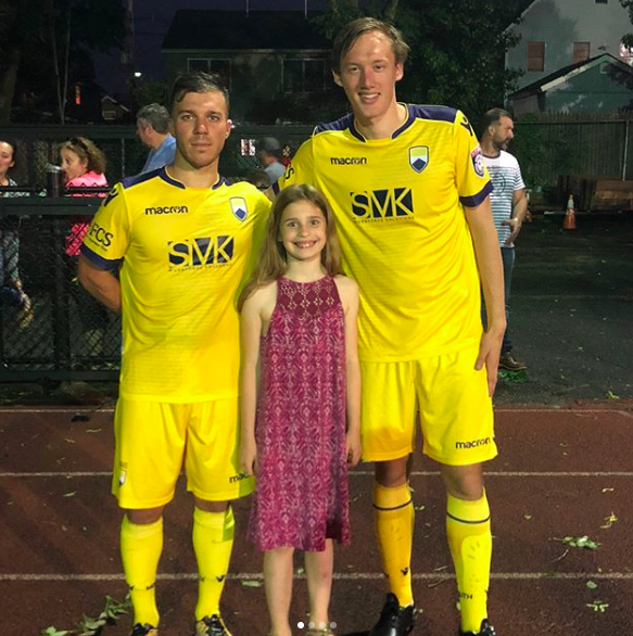 Helena LeCompte with two of her favorite FC Monmouth players John Antunes and Zachary Pereira