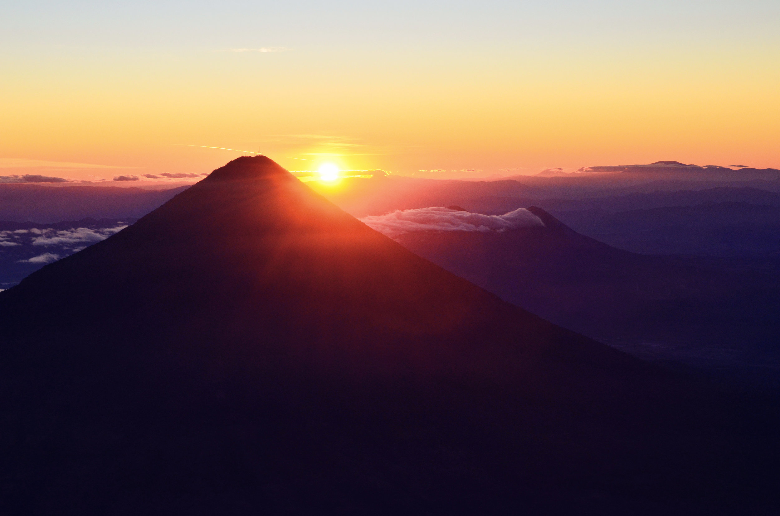 The sunrise over a chain of volcanoes