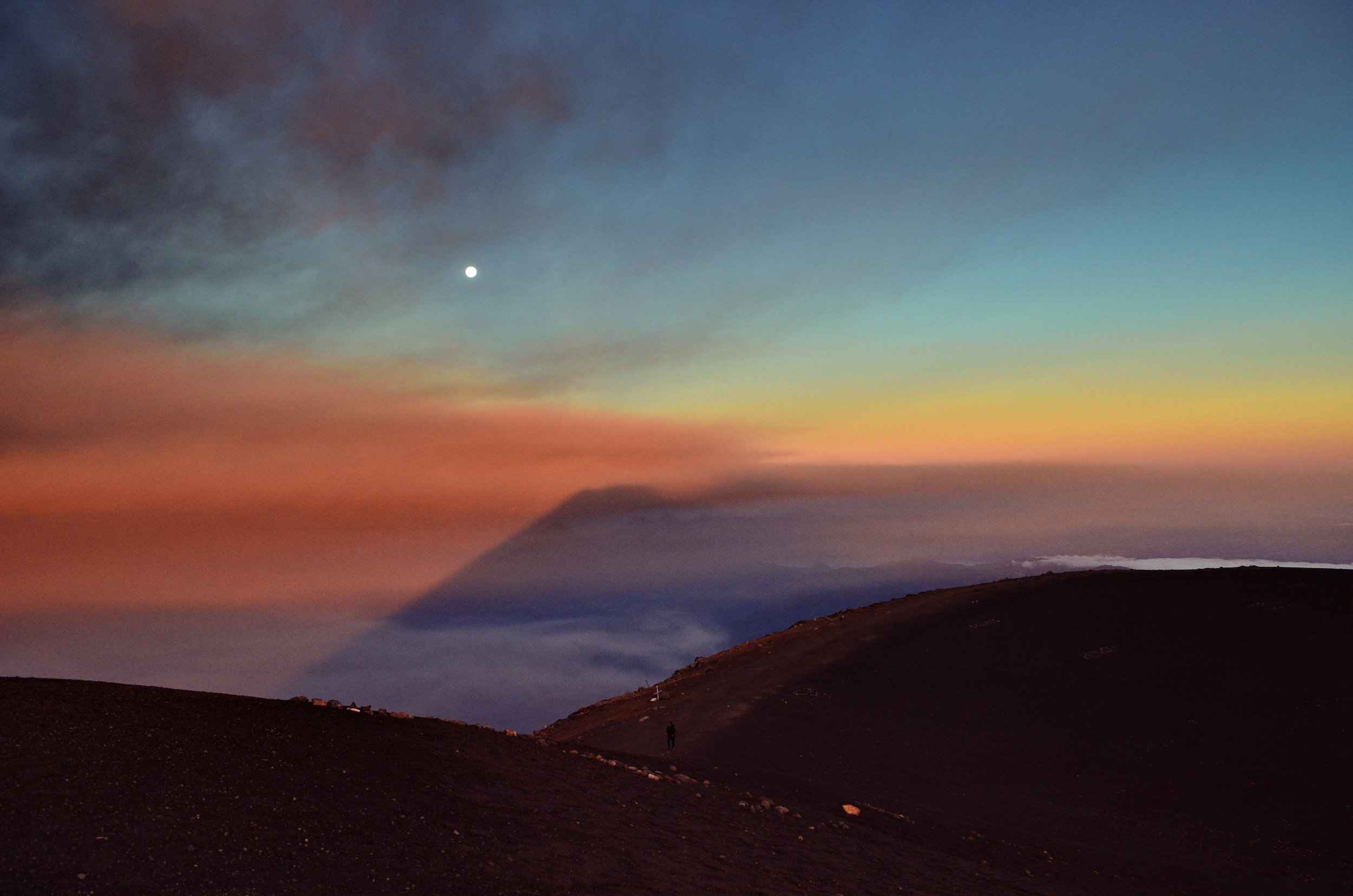 A full moon hovers over the alien landscape at the summit of Acatenango